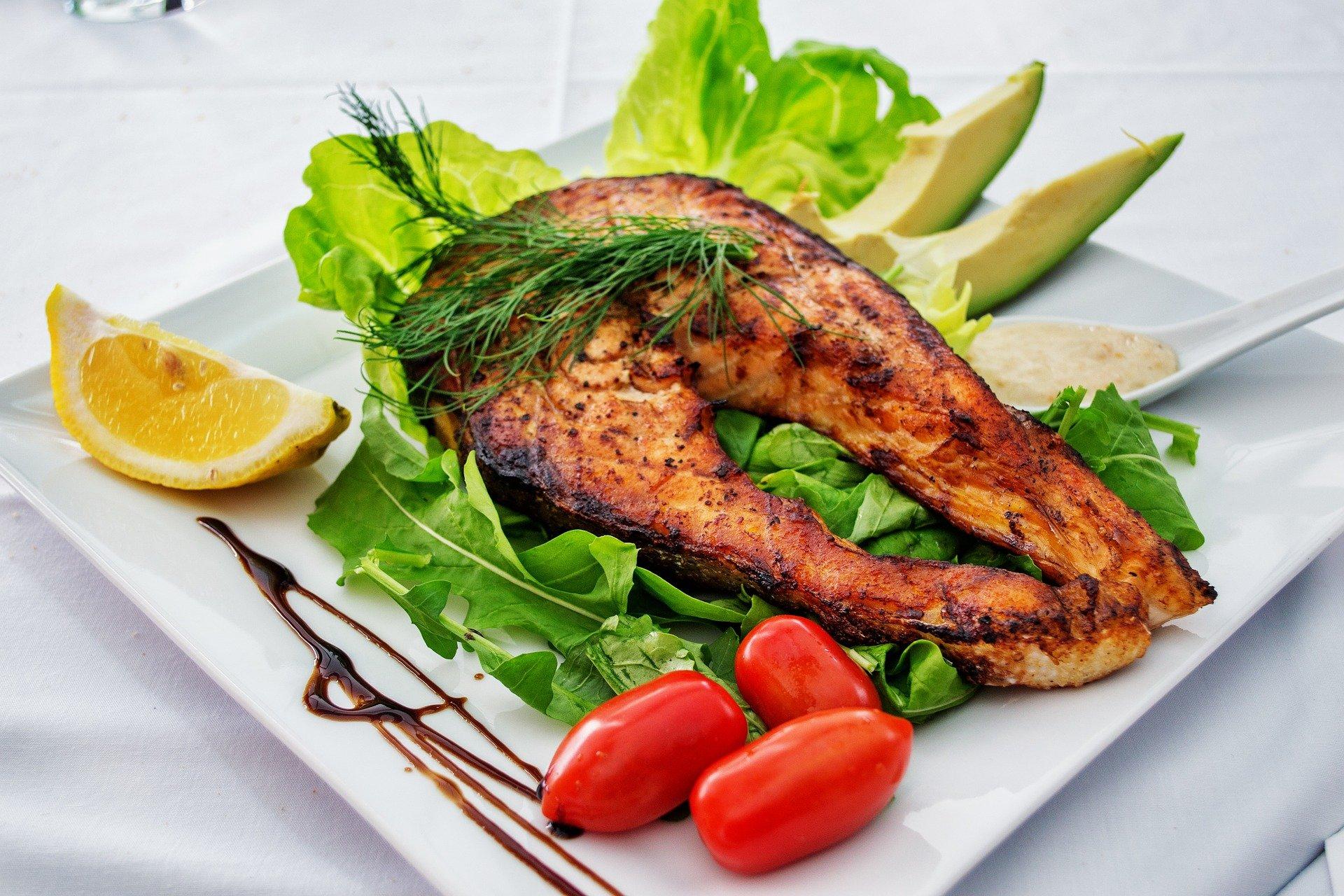 Salmon on lettuce.