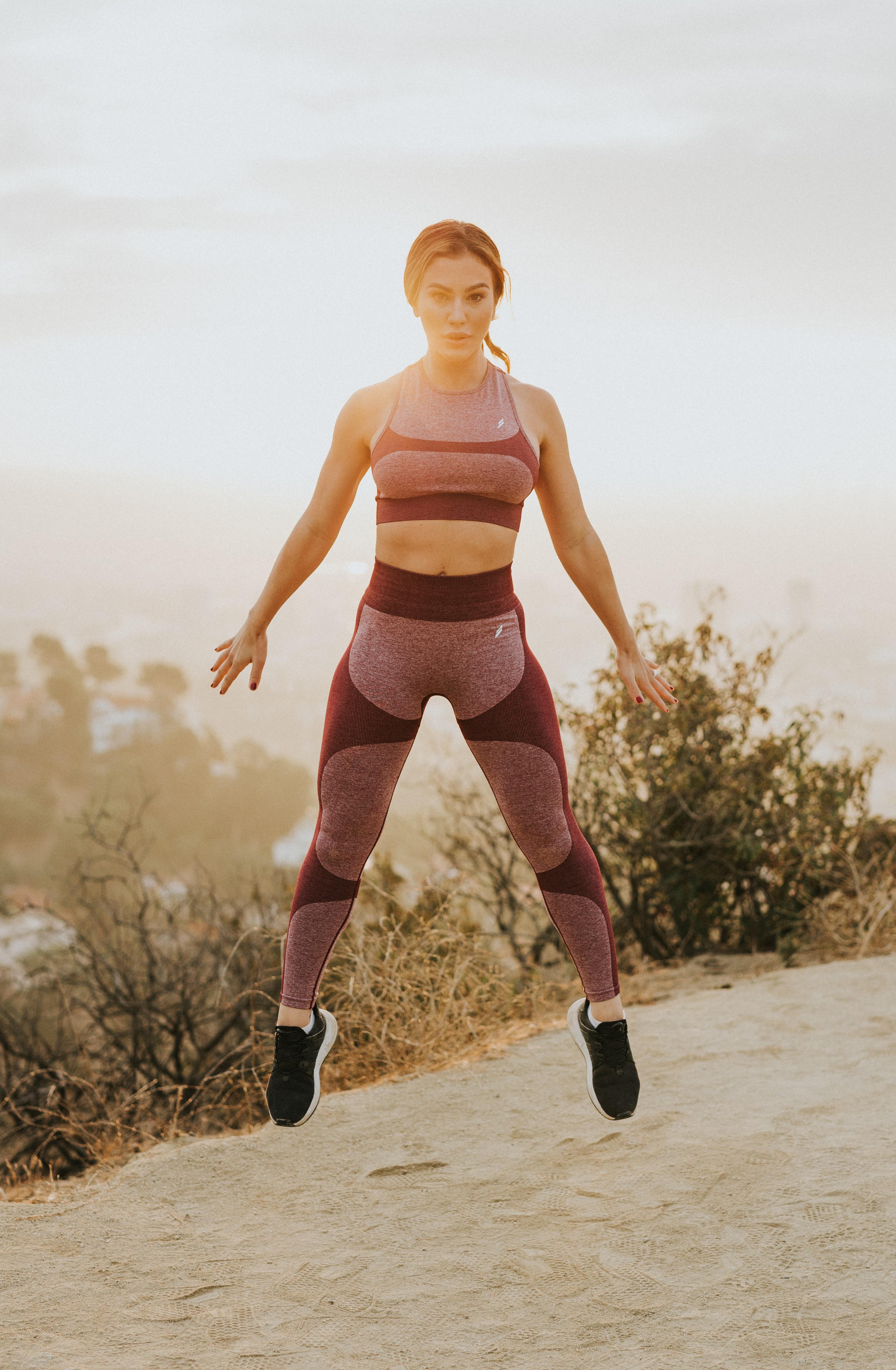 Sportive woman jumping.
