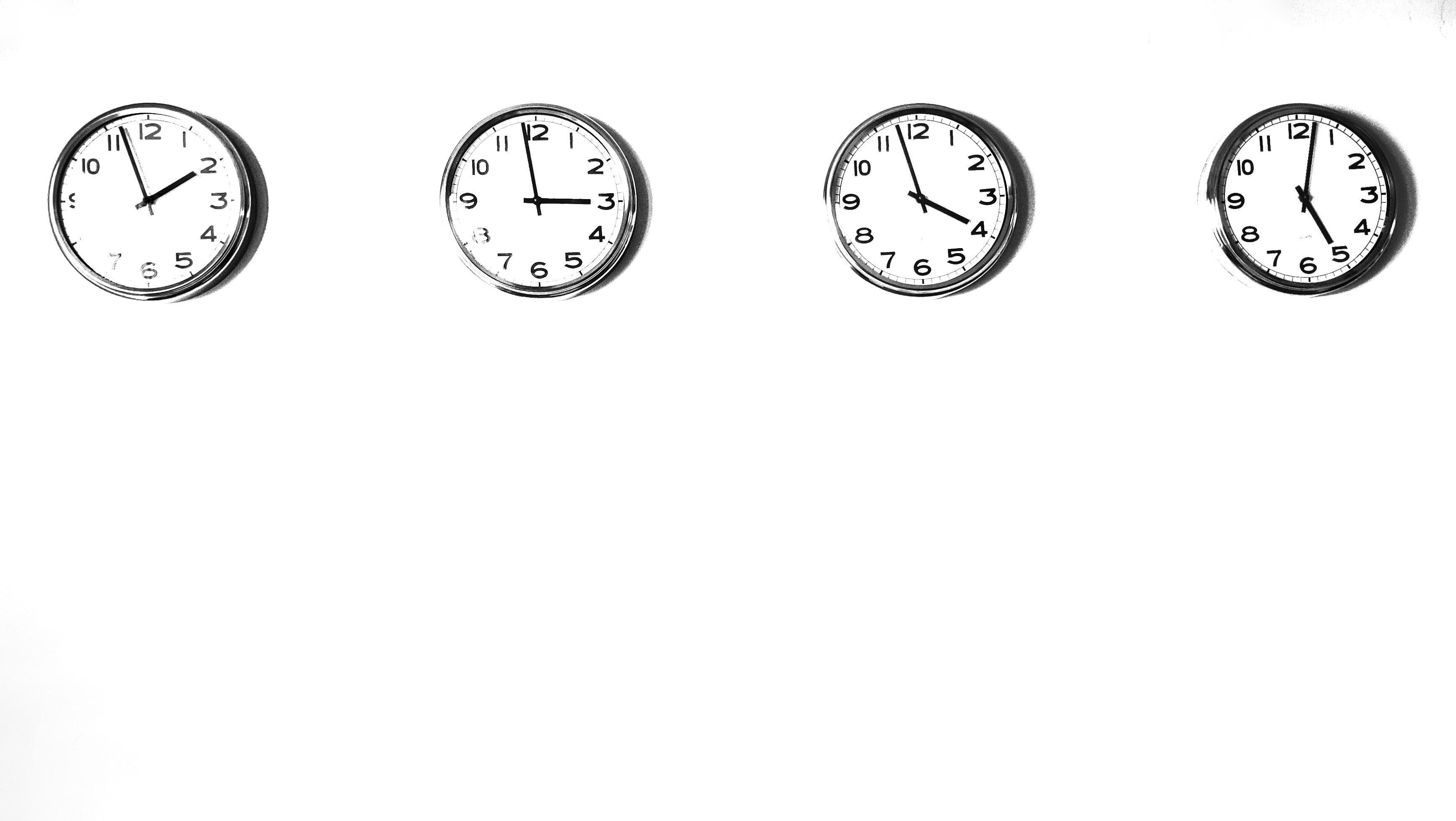 Four clocks showing different times.