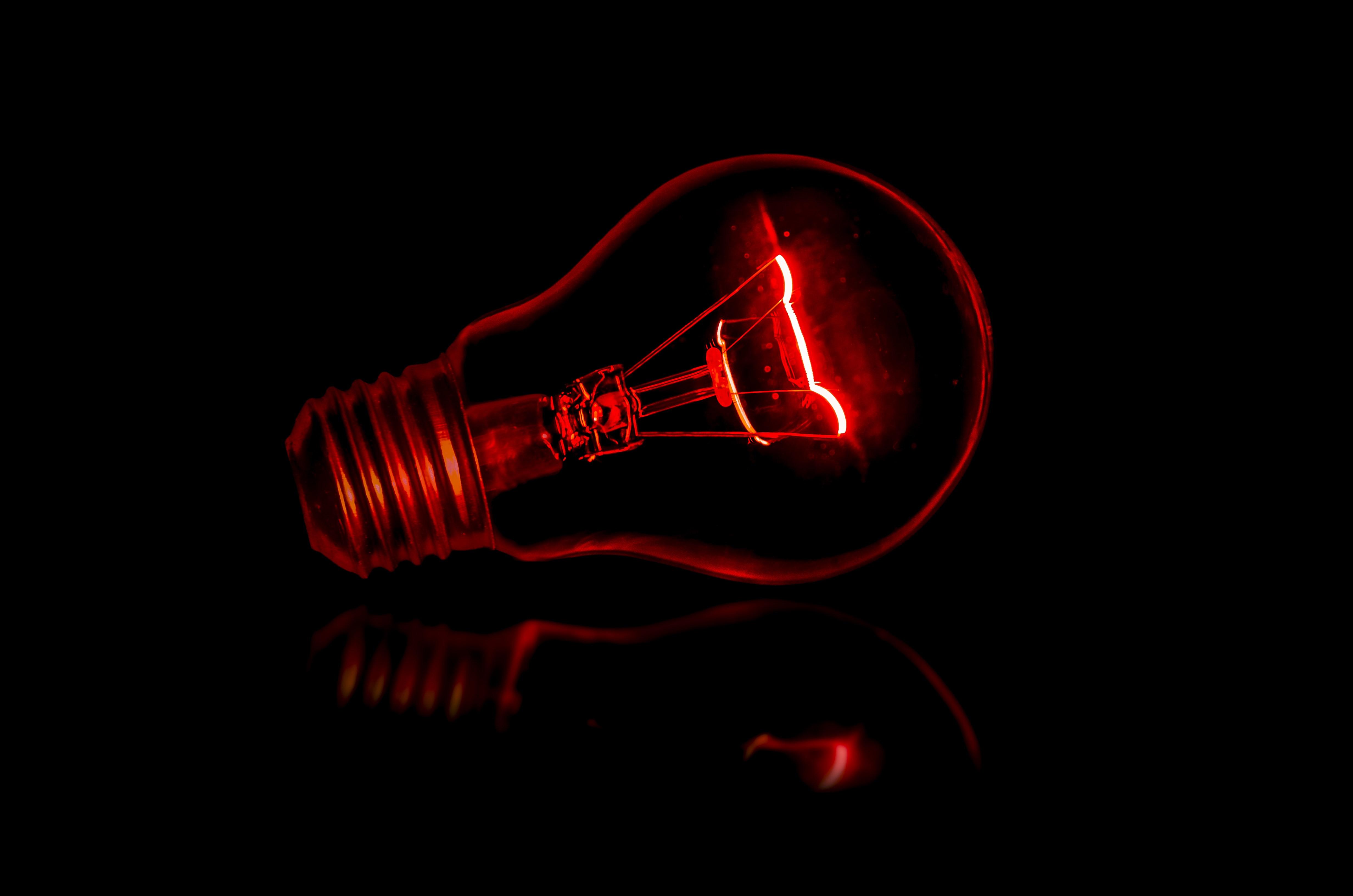 Red light bulb in the dark.