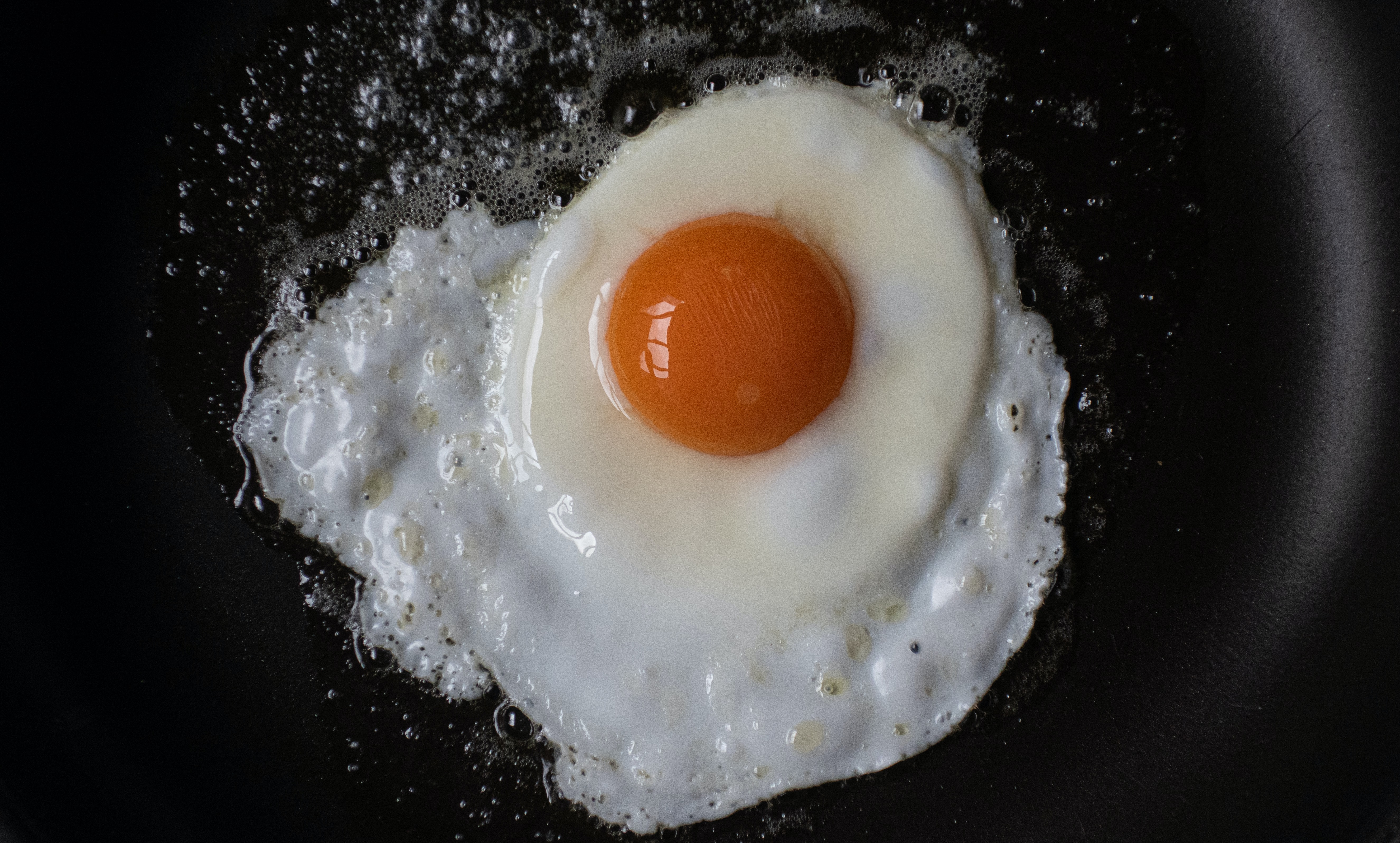 Fried egg in a pan.