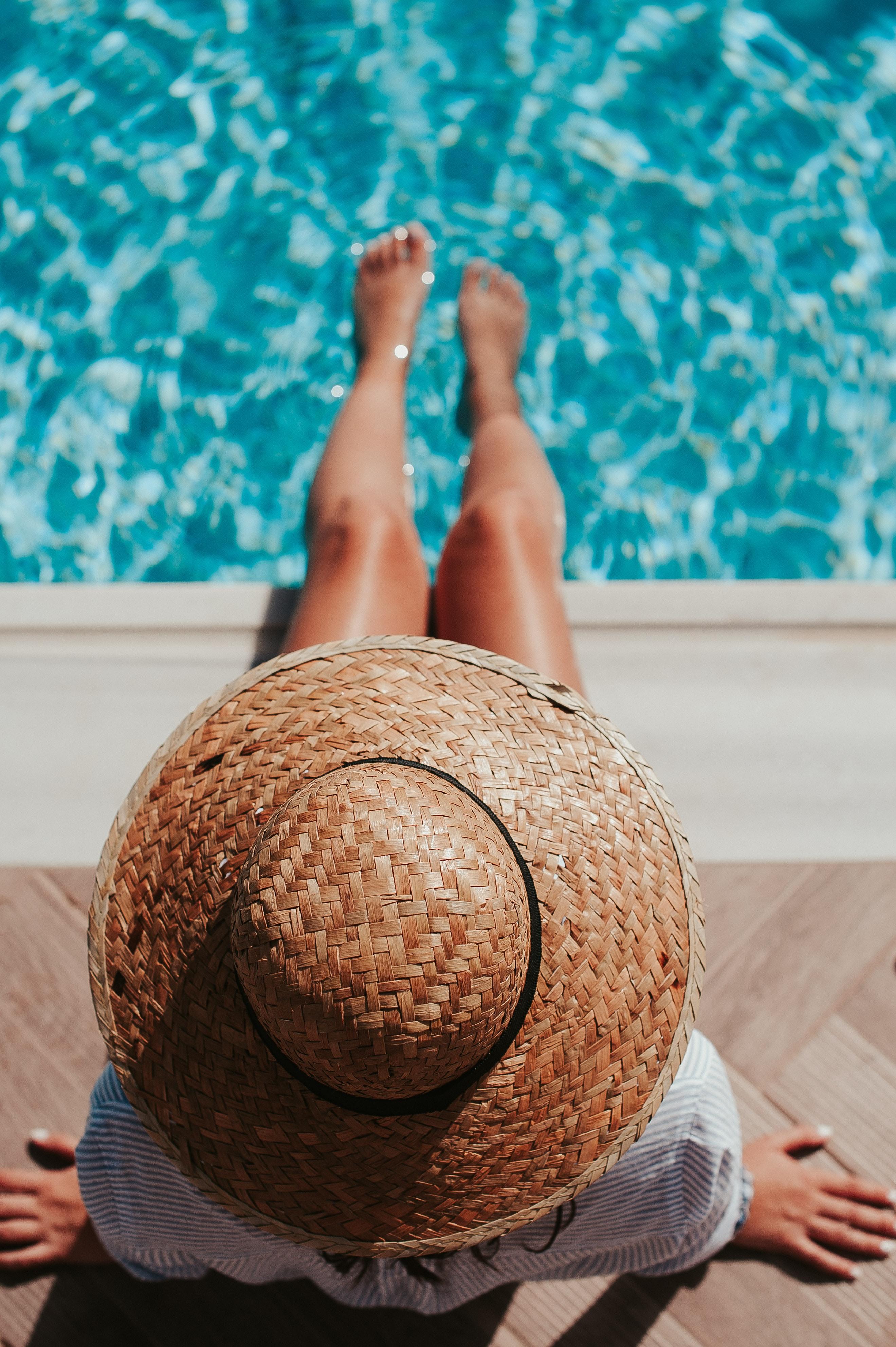 Woman setting both feet on pool.