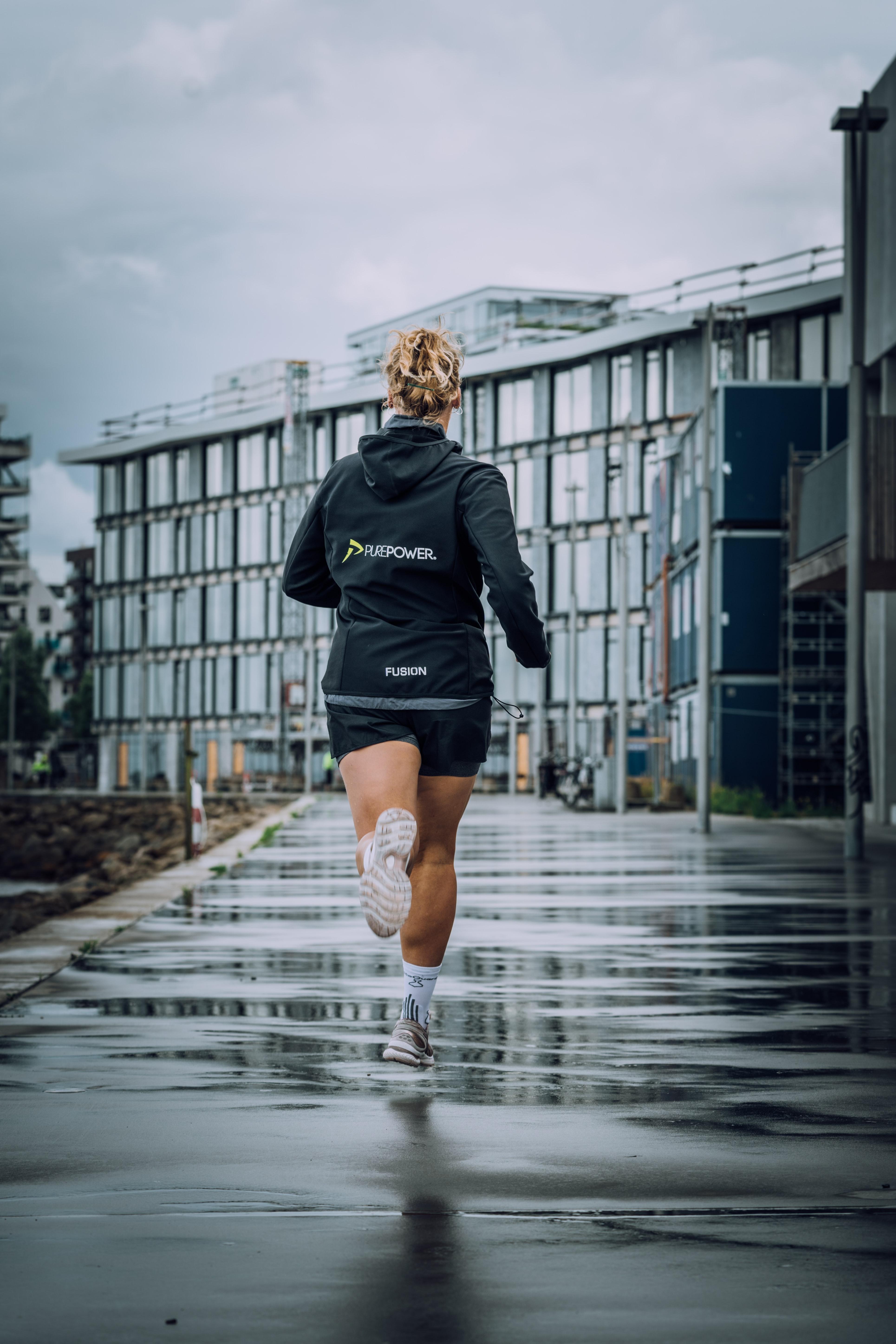 Woman running in the rain.