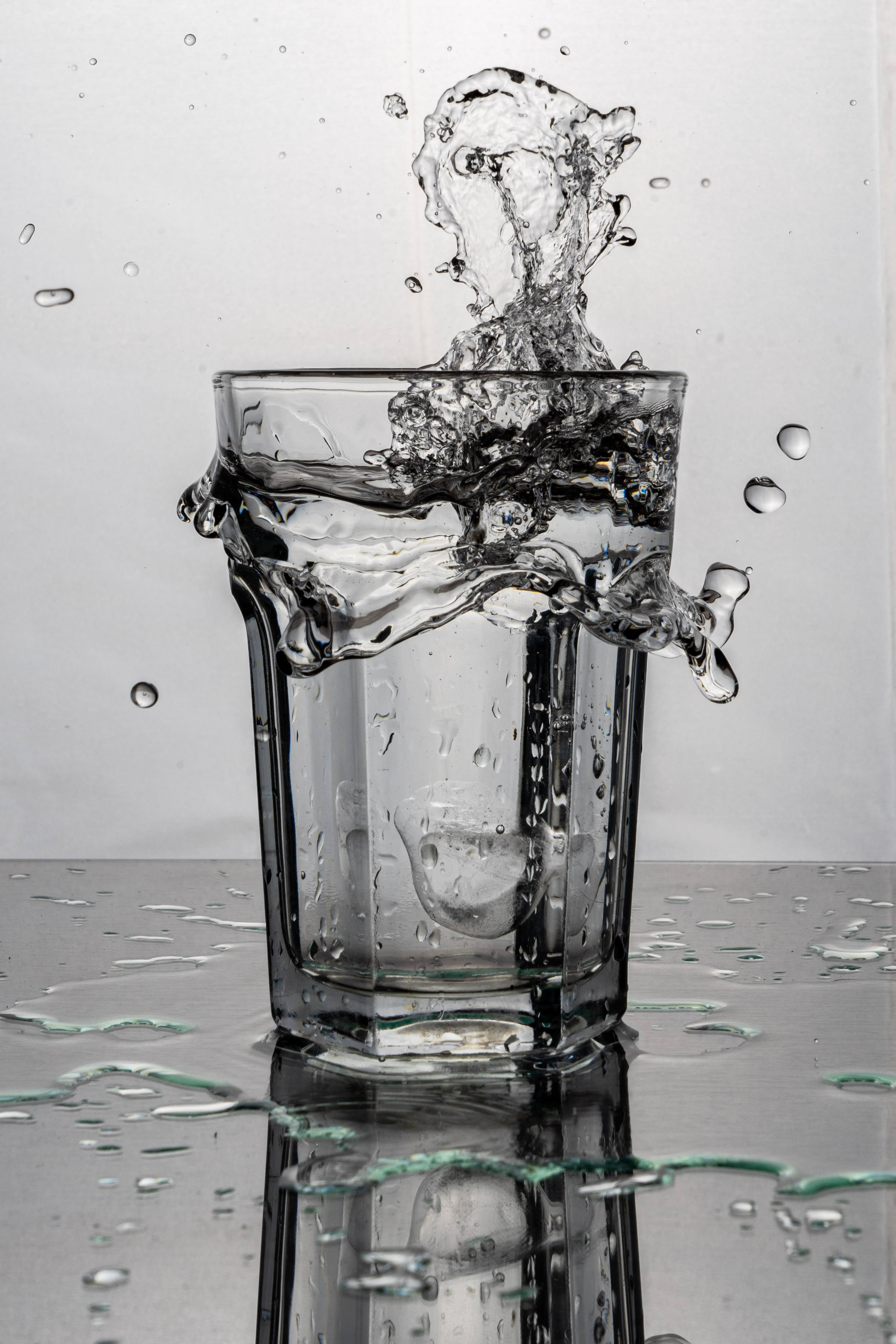 A glass filled with water.