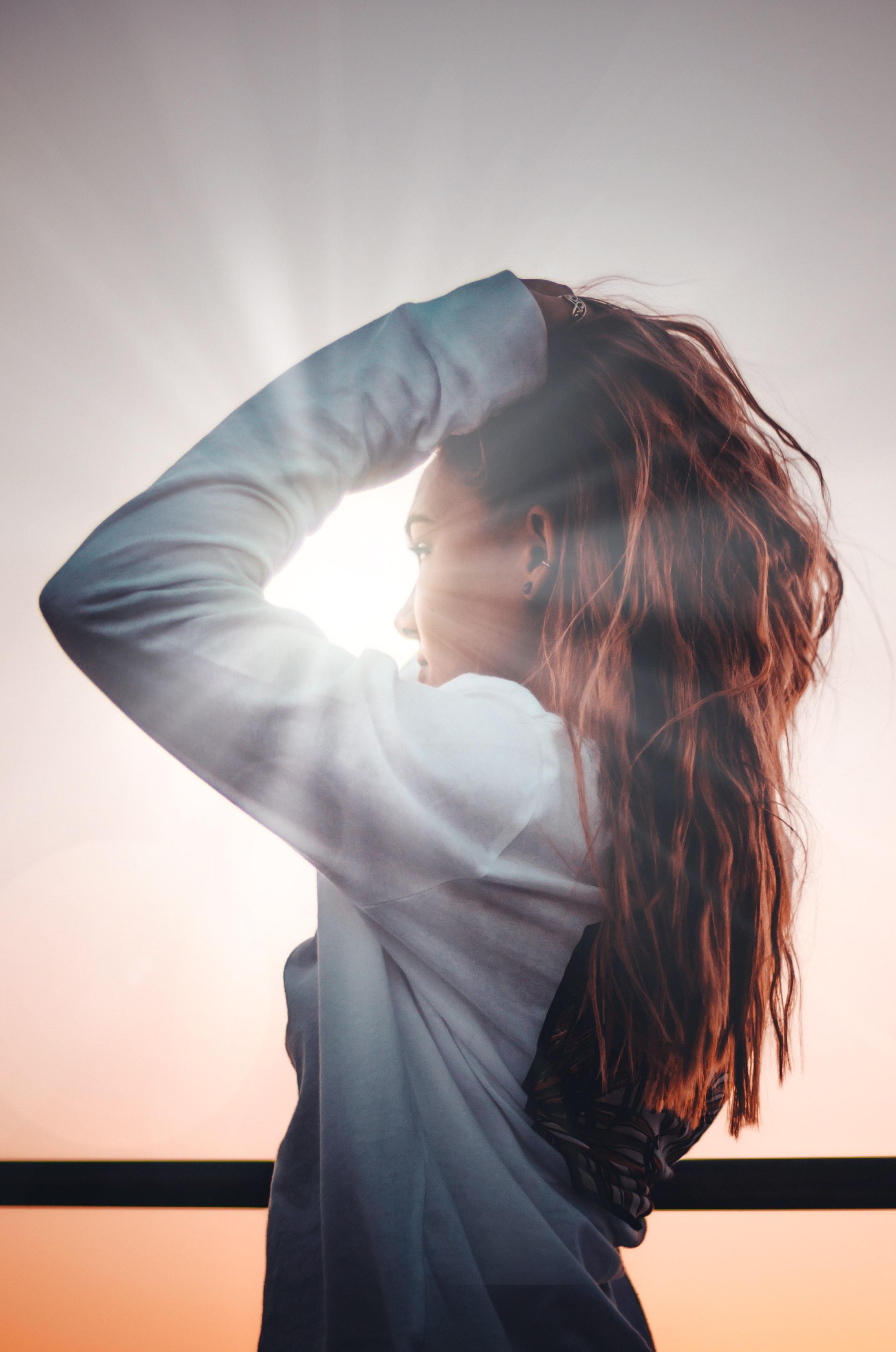 Sun shining on woman.