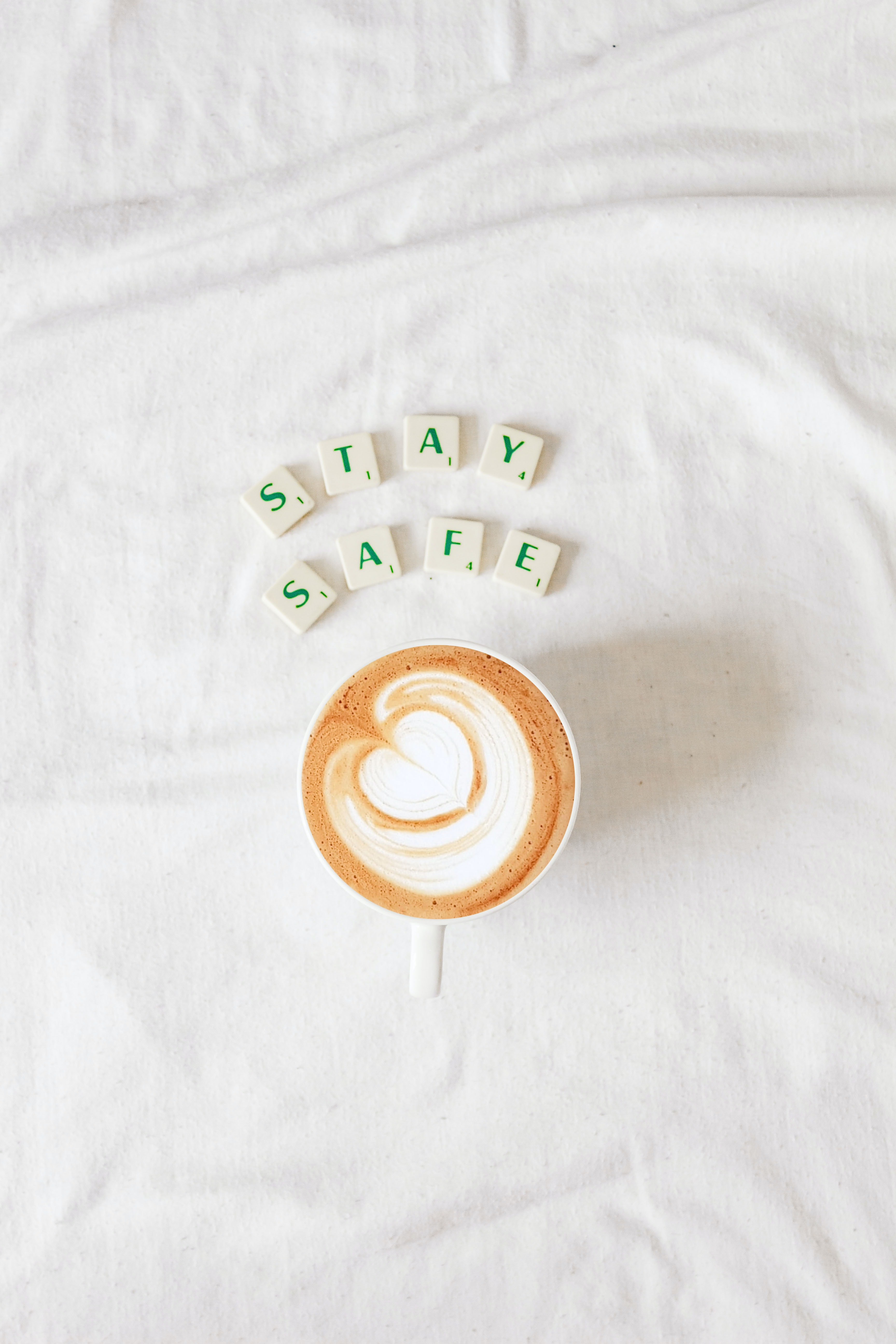 coffee with puzzle piece saying stay safe.