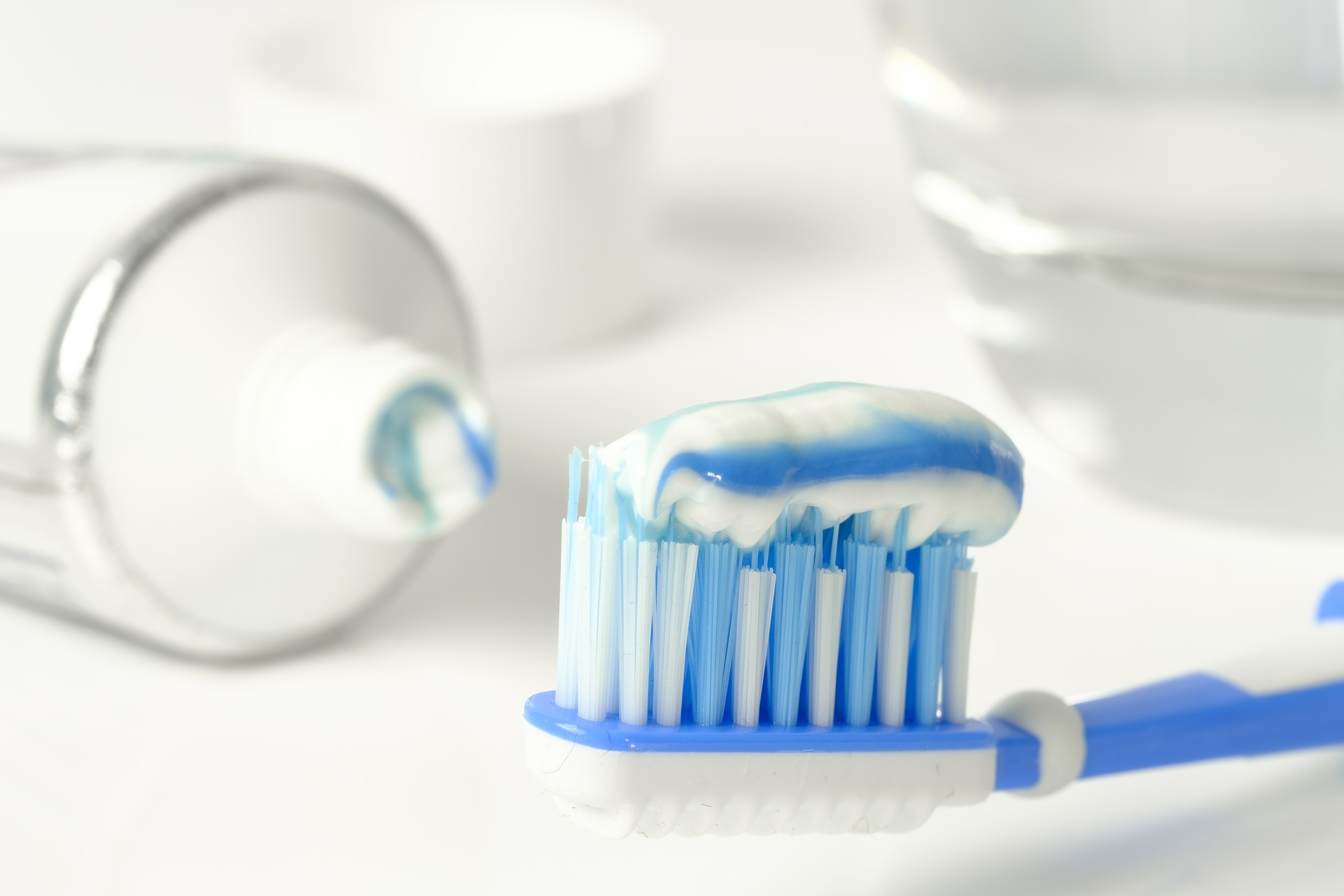 blue-white toothpaste on a blue toothbrush.