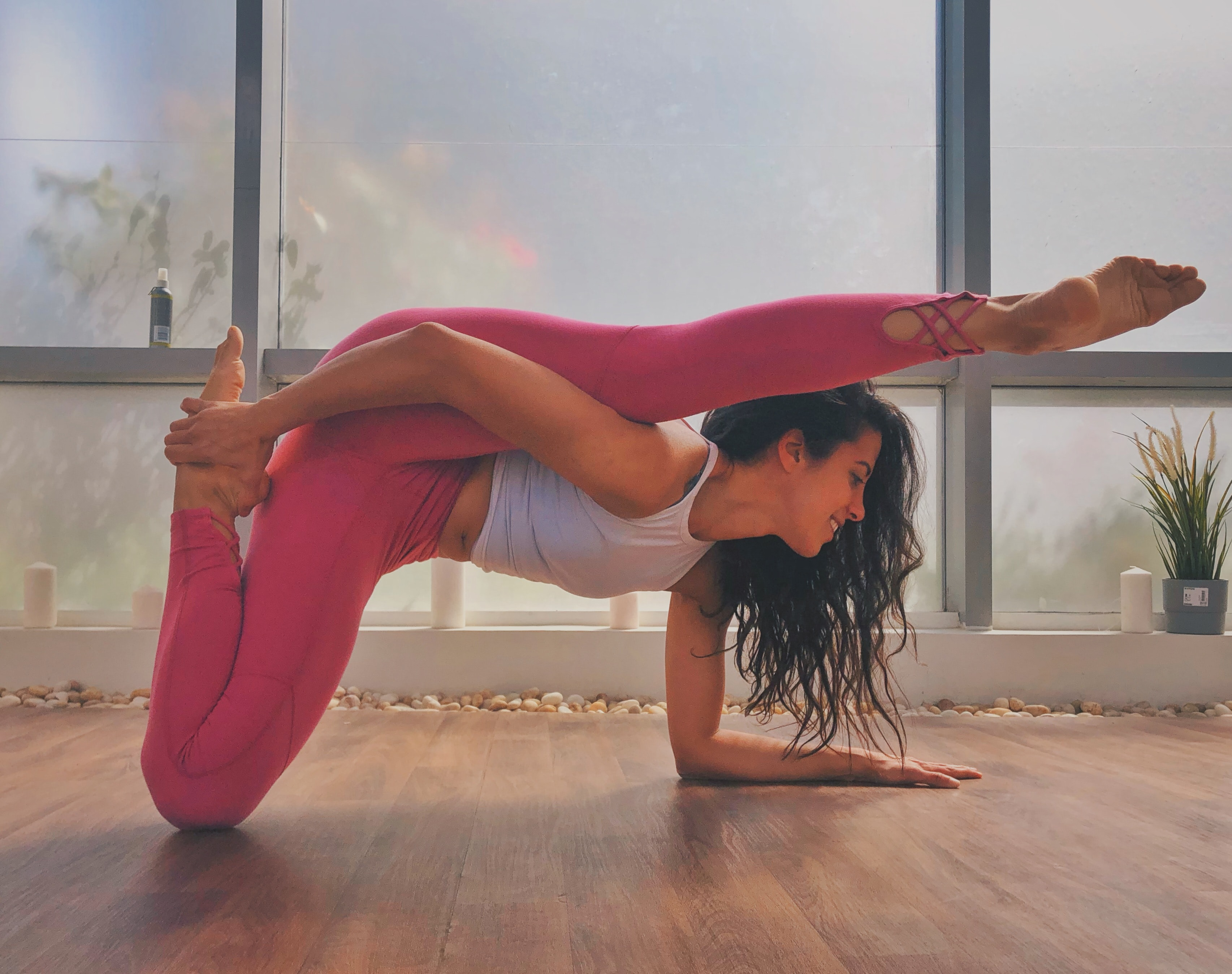 Flexibel woman doing a deep stretch.
