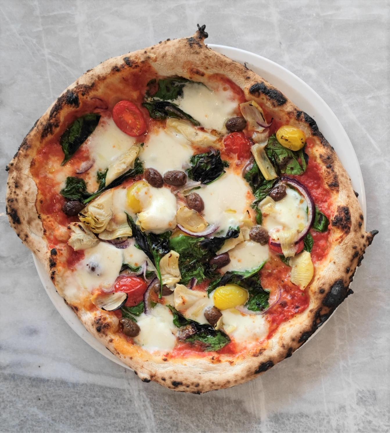 pomodoro, fior di latte, grana padano, spinach, tomato, red onion, artichoke, olives, oregano VEG