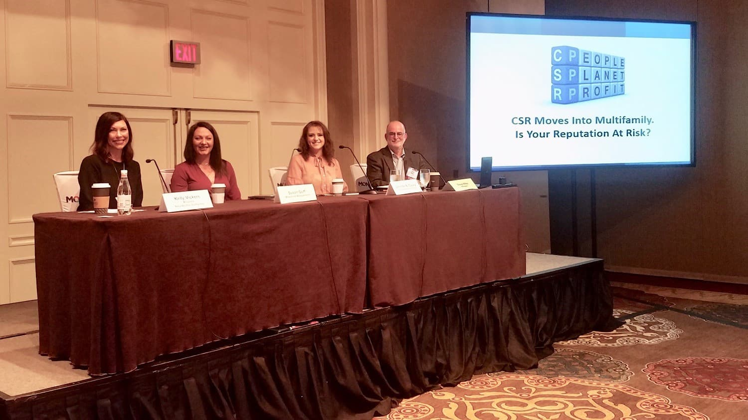 pannel of men and women presenting on stage at crittenden multifamily conference