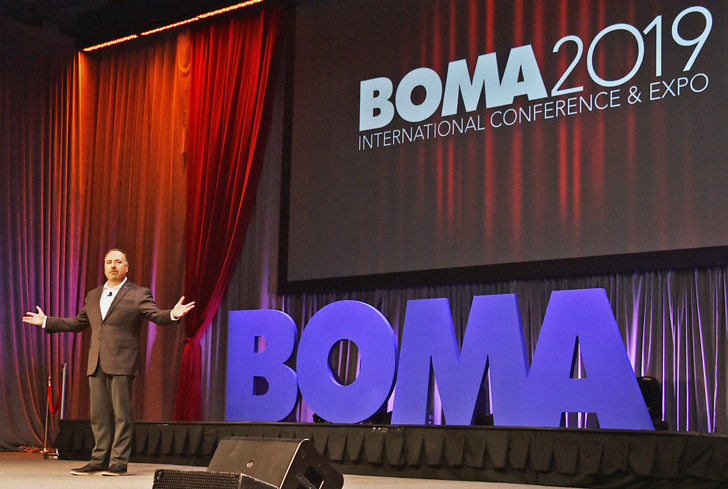 man on stage welcoming audience to BOMA International Annual Conference