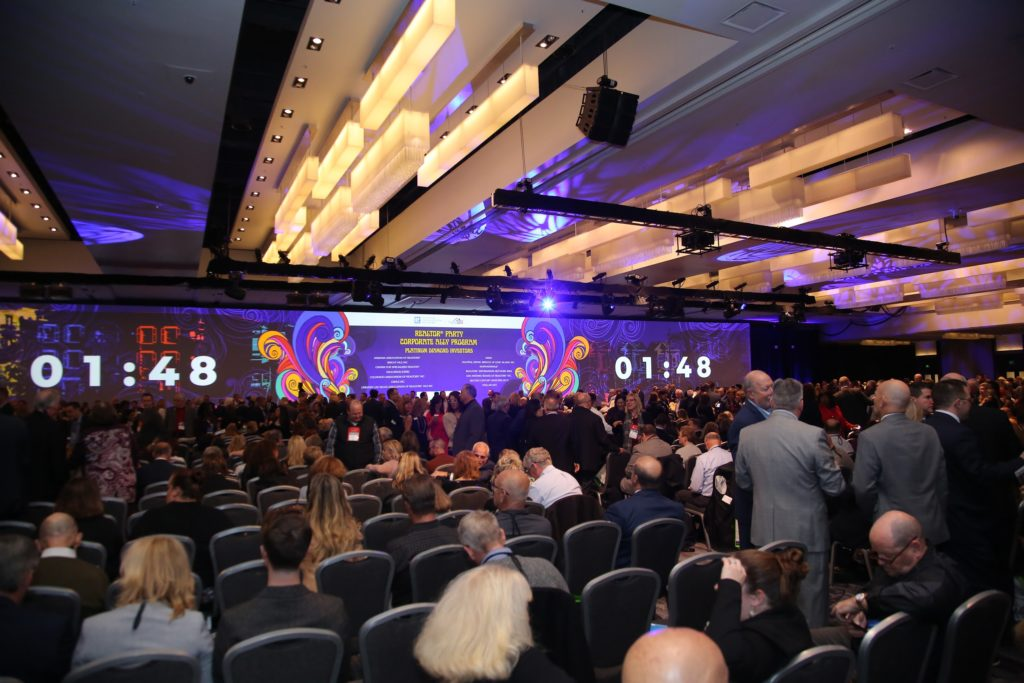 view of conference stage with a clock counting down to the start of a session at REALTORS Conference and Expo