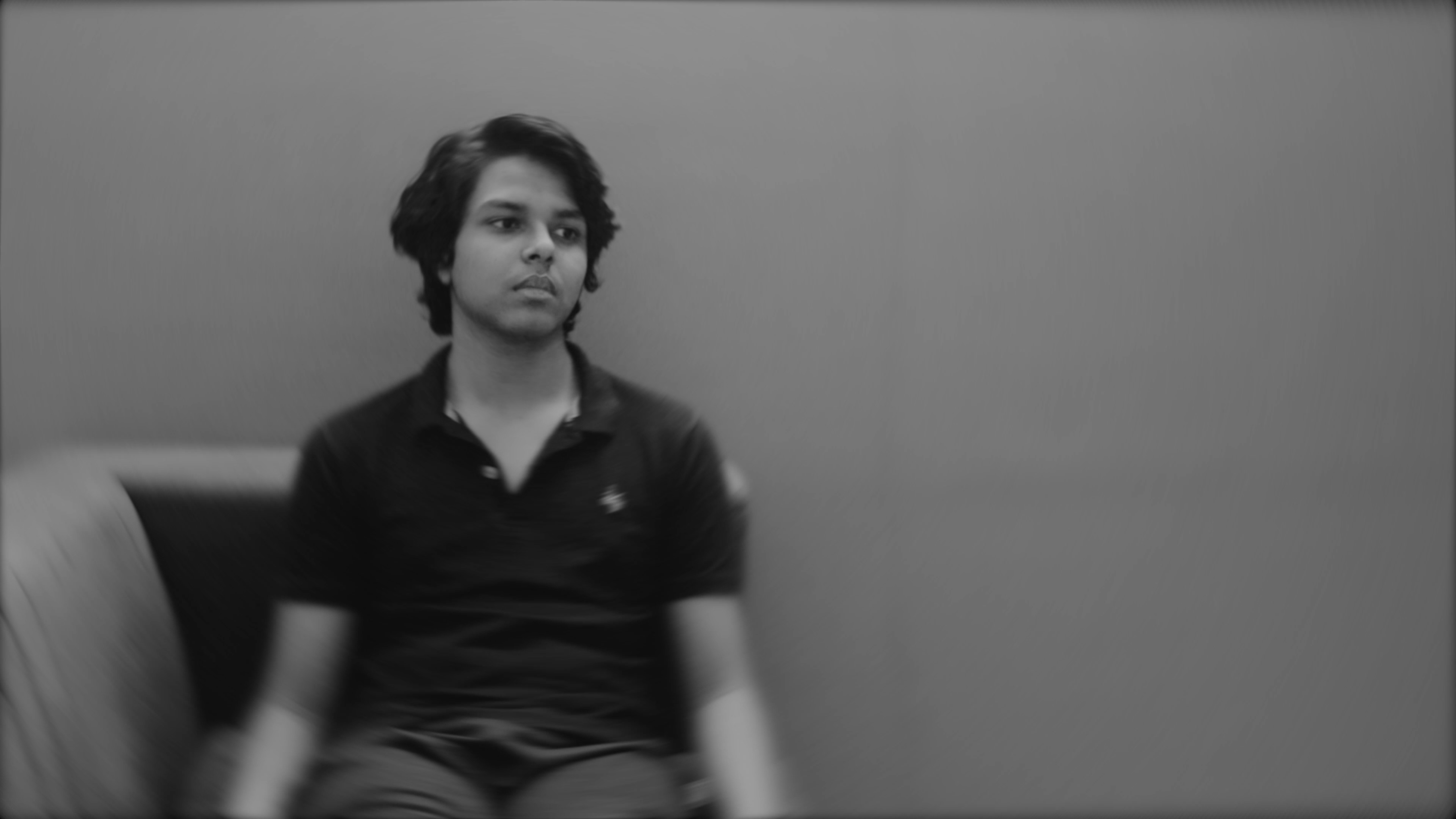 Still images from the short film distorted showing a person sitting on the couch like a statue.