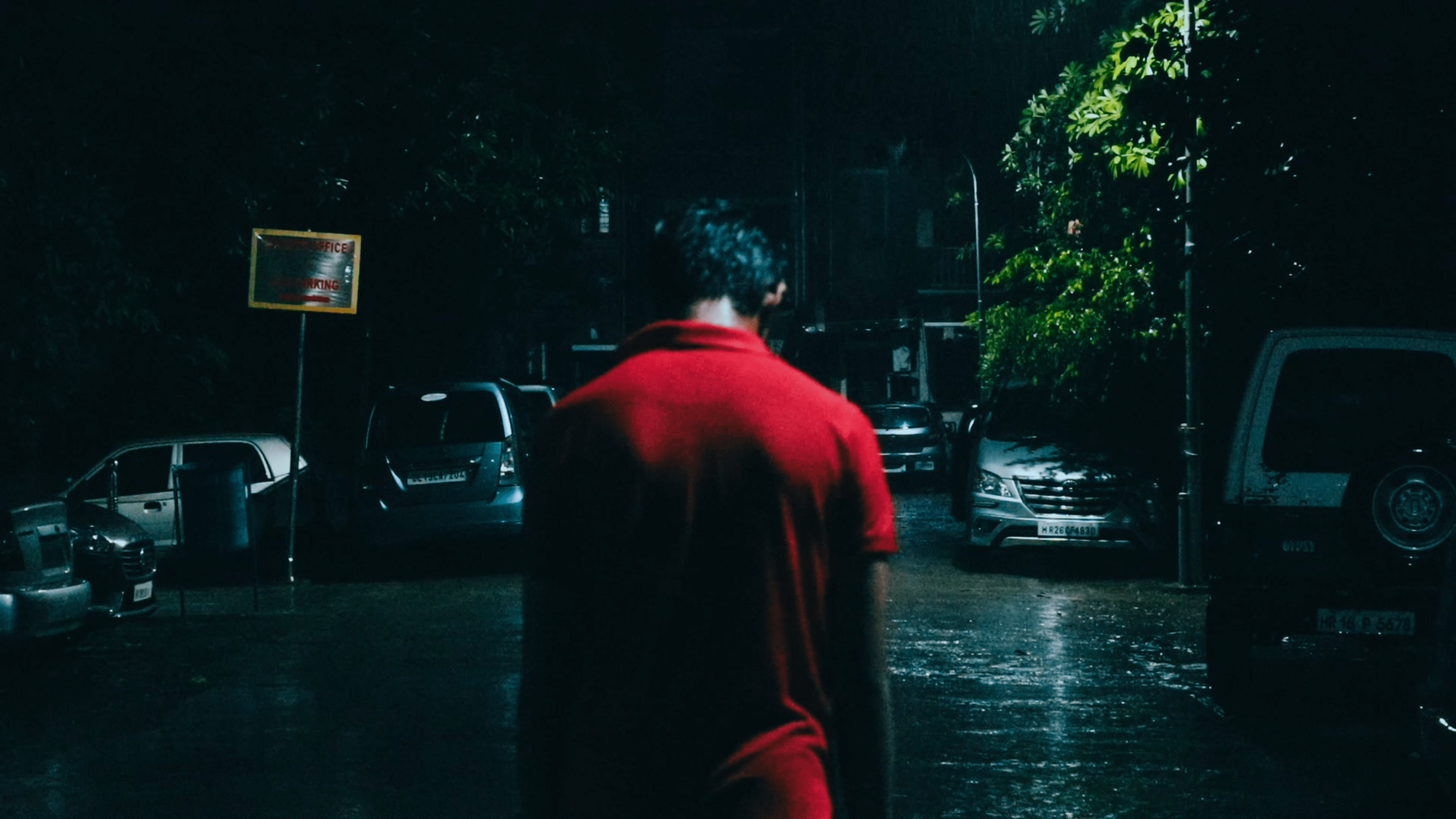 Still images from the short film distorted showing a person walking in the rain.