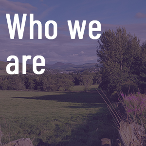 Who we are tile with scenic background
