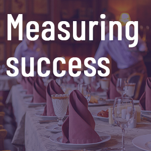 Measuring success tile with catering in background