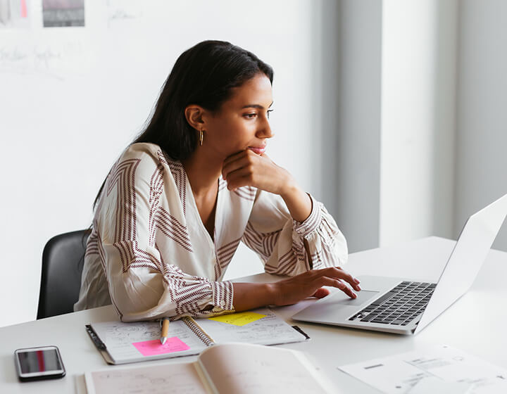 Woman working on office laptop