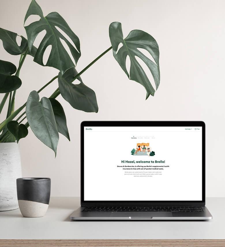 Brella health insurance website on a laptop