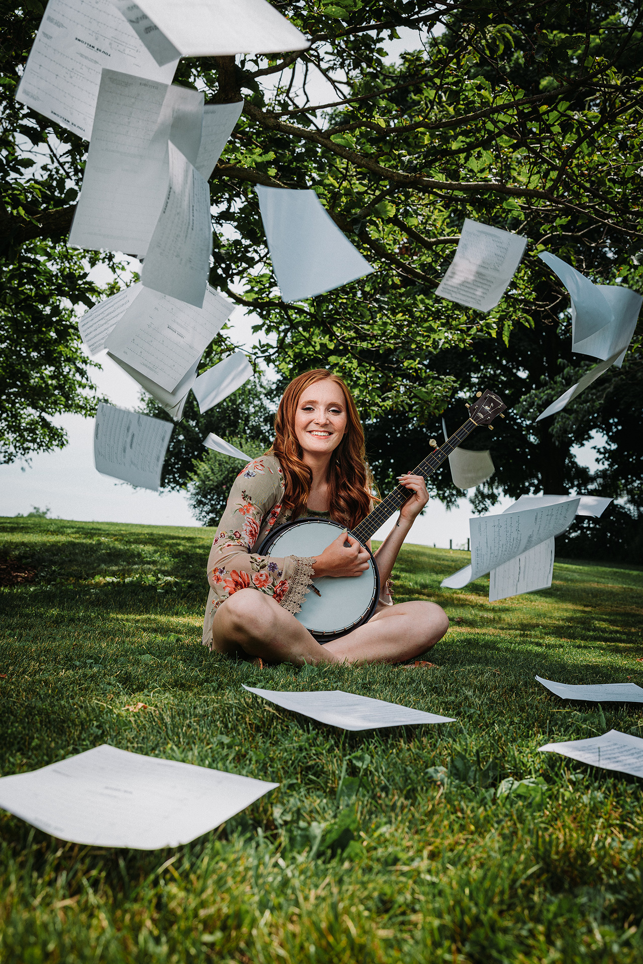 Senior photo of a girl with a banjo and sheet music