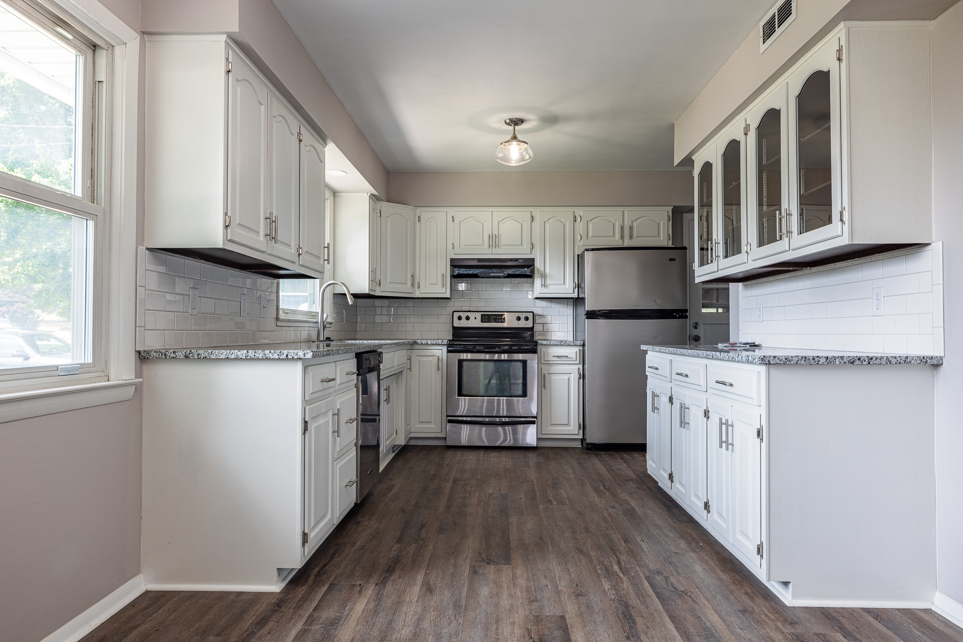 Real Estate photo of black and white kitchen.