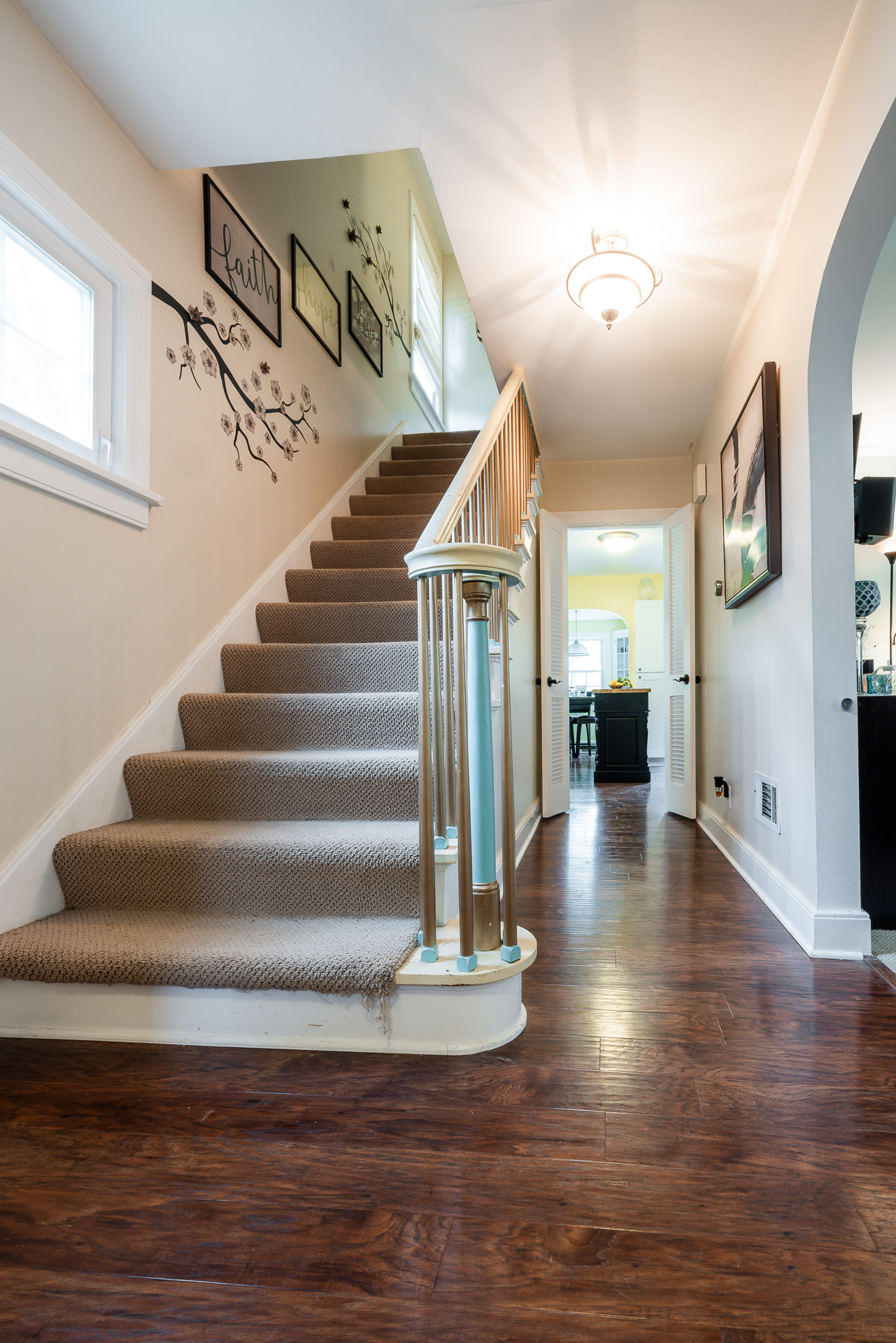 Real Estate photo of interior staircase and hallway.