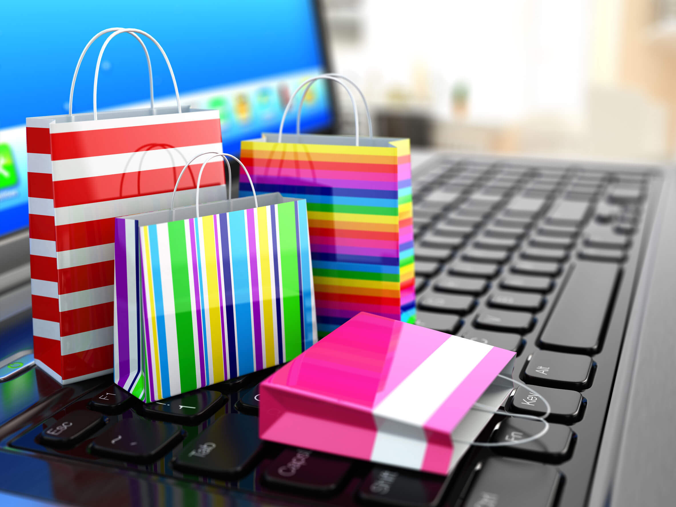 Shopping bags in front of desktop computer