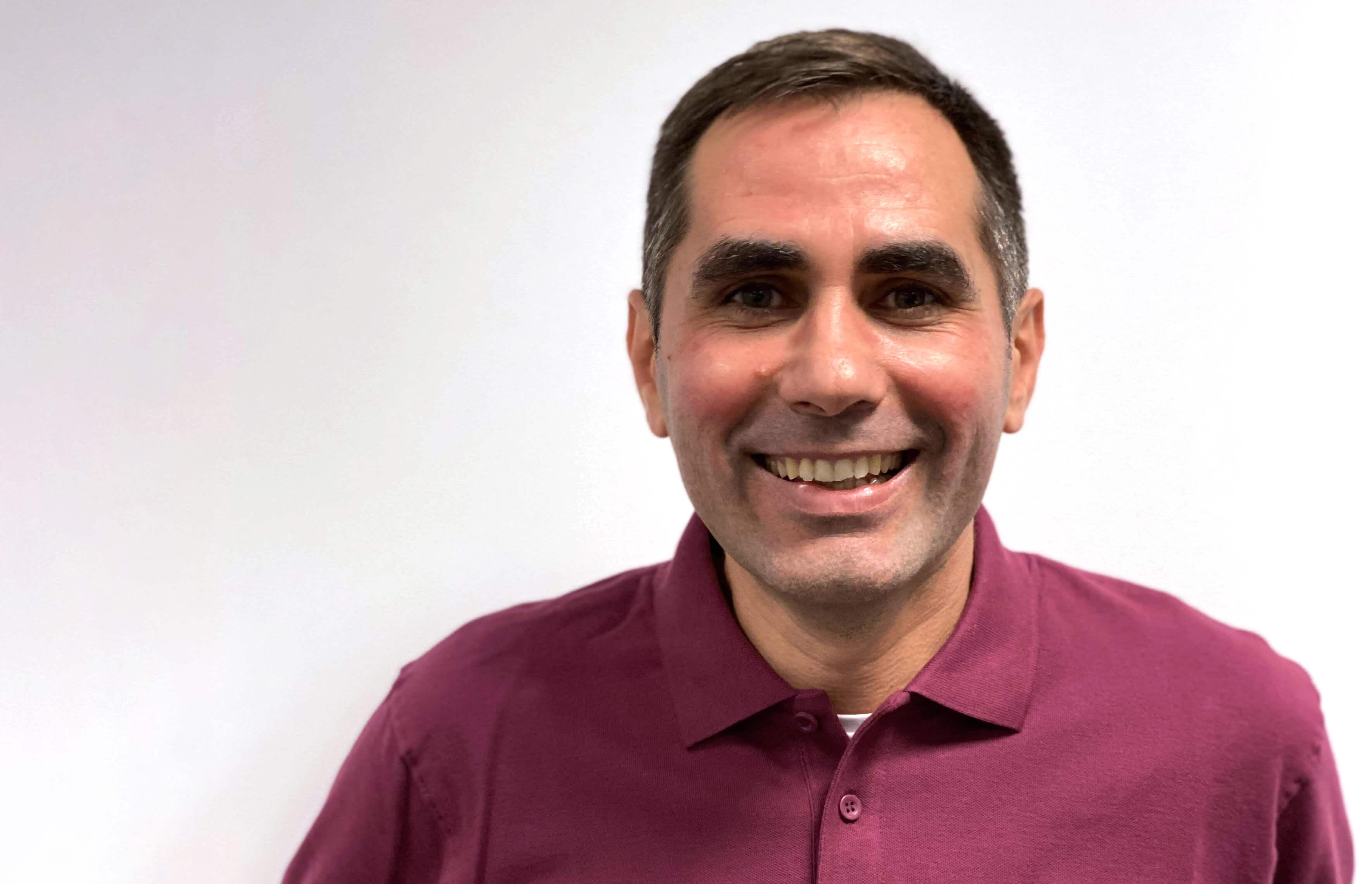 Portrait of Mircea Stan smiling