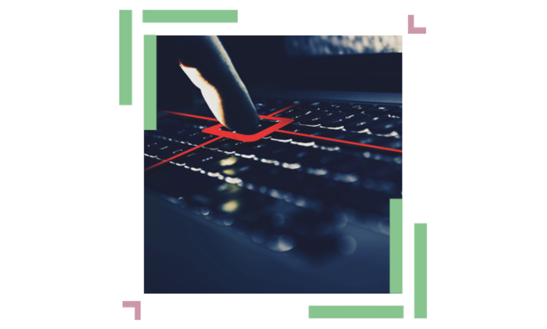 a finger pressing a key on a laptop's keyboard
