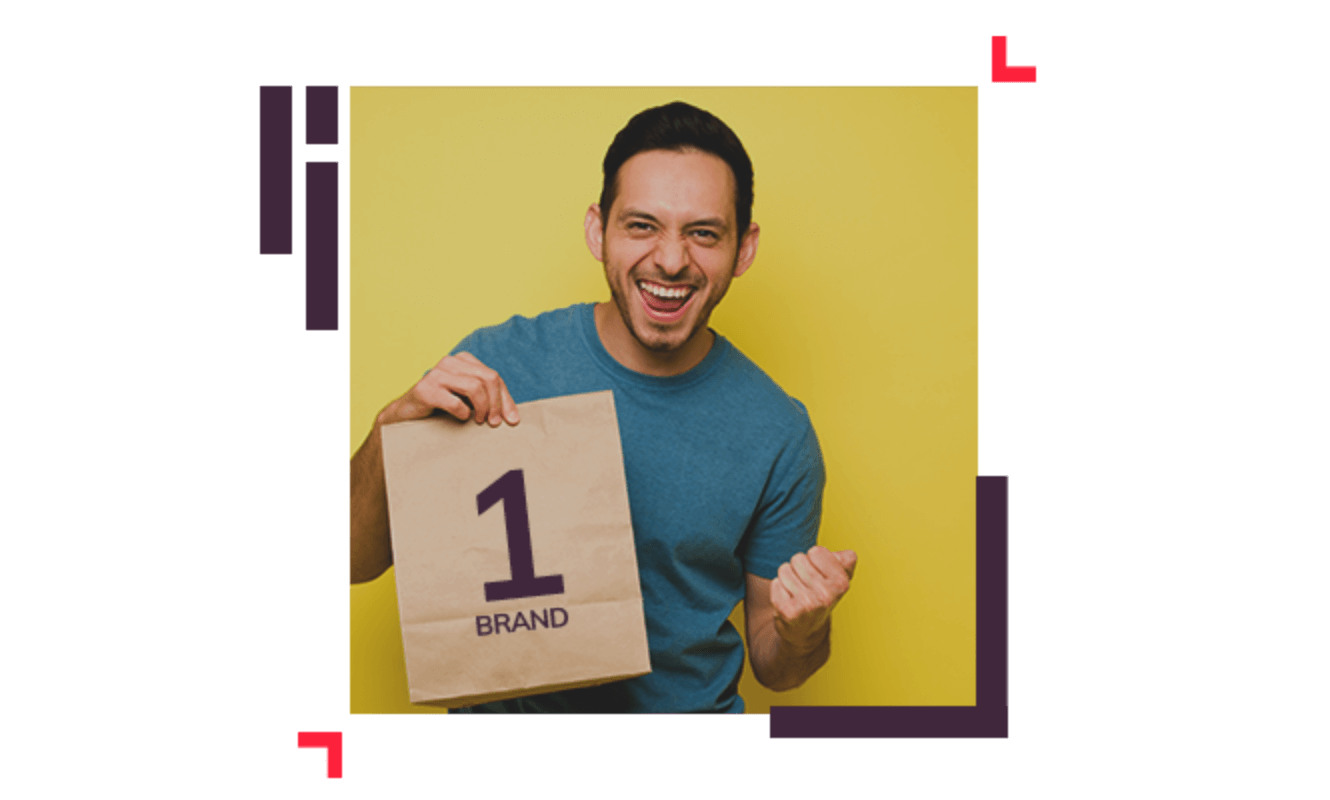 """happy person holding a paper bag with """"1 brand"""" written on it"""