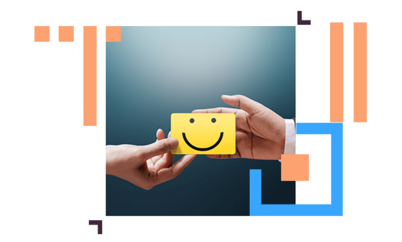 hands holding a card yellow with a smiling face on it