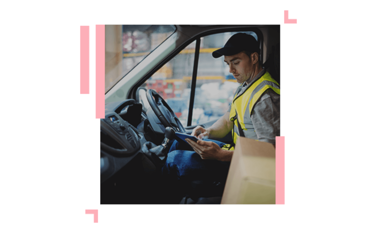 Delivery driver looking on a tablet