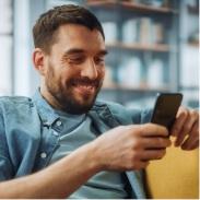 Mand on sofa holding phone
