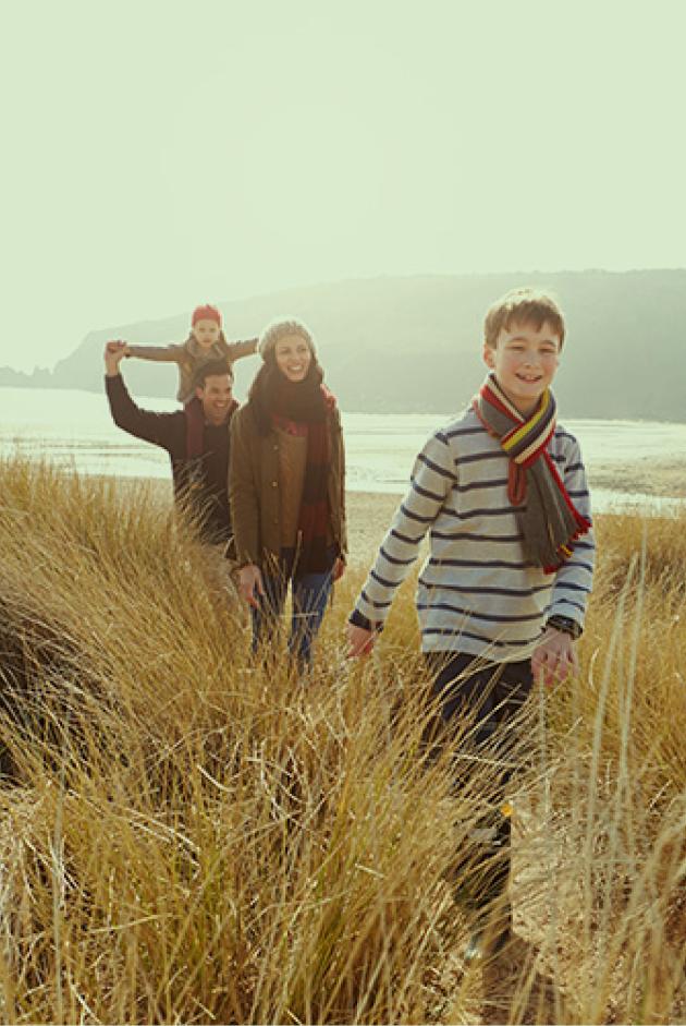 Family walking by beach