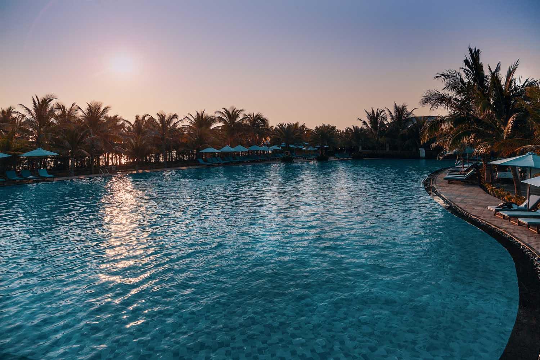 Duyen Ha resort Cam Ranh Beach pool at sunset photo by Halo Digital Media - Vietnam hotel Photography