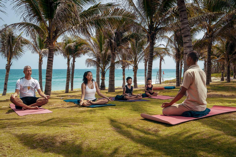 Duyen Ha resort Cam Ranh Morning familyt yoga photo by Halo Digital Media - Vietnam hotel Photography
