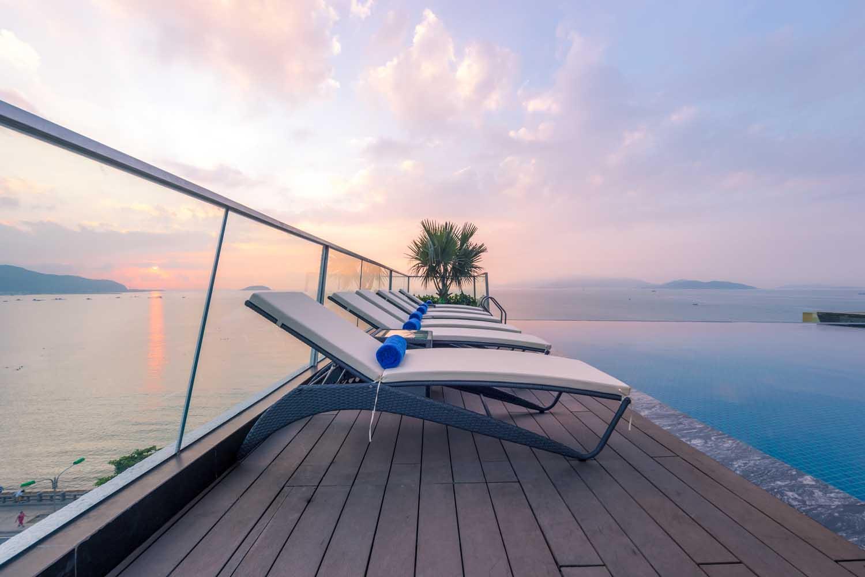 Sunbeds and pool Royal Boton Blue Hotel & Spa - Photos by Halo Digital media - Hotel & Resort Photography - Vietnam - Nha Trang