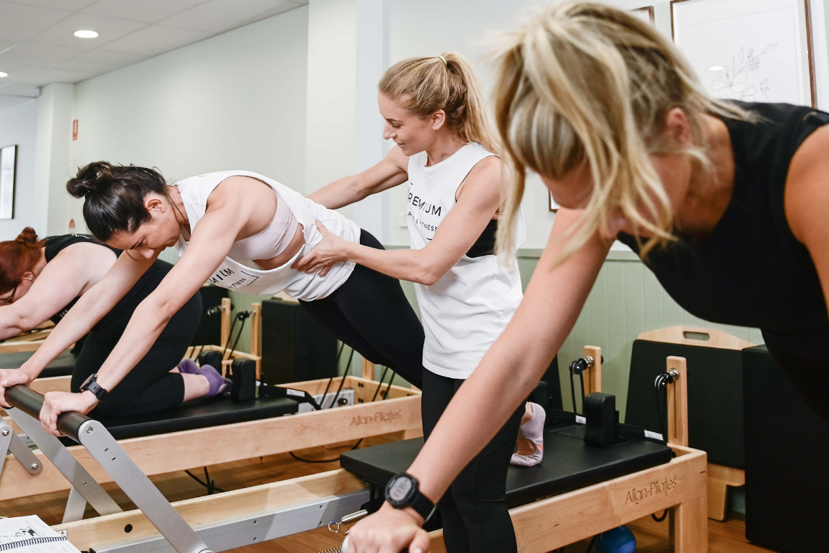 Teacher instructs student in Pilates instructor course