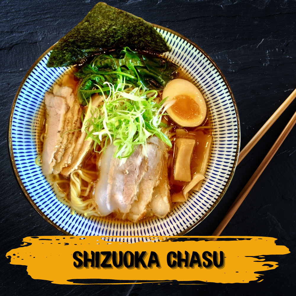 This ramen noodle dish contains an elegant clear shoyu broth, two types of chasu pork meat, spinach, bamboo, green garnish, nori seaweed and ajitama egg.
