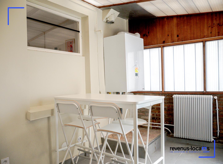 Photos d'une veranda avec chaudière