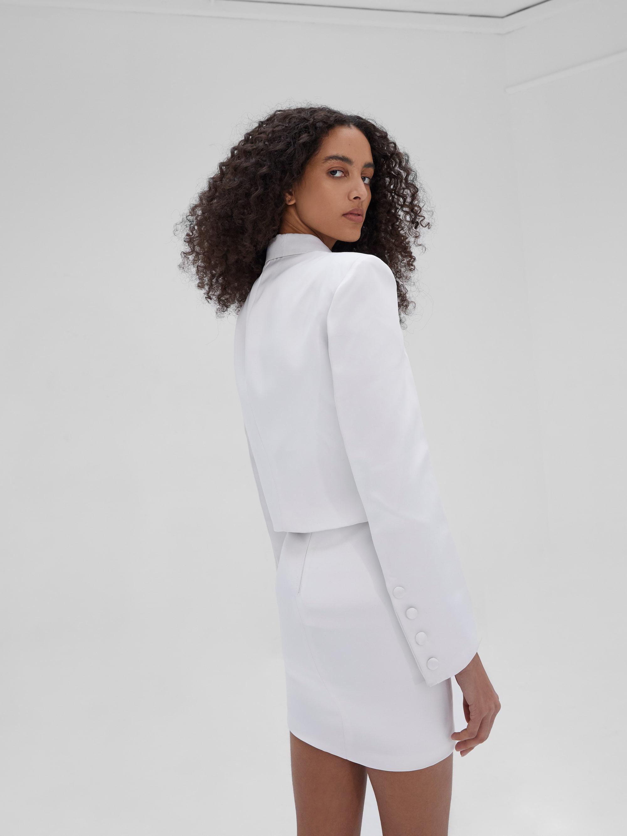 View 2 of model wearing Kin Cropped Blazer in black.