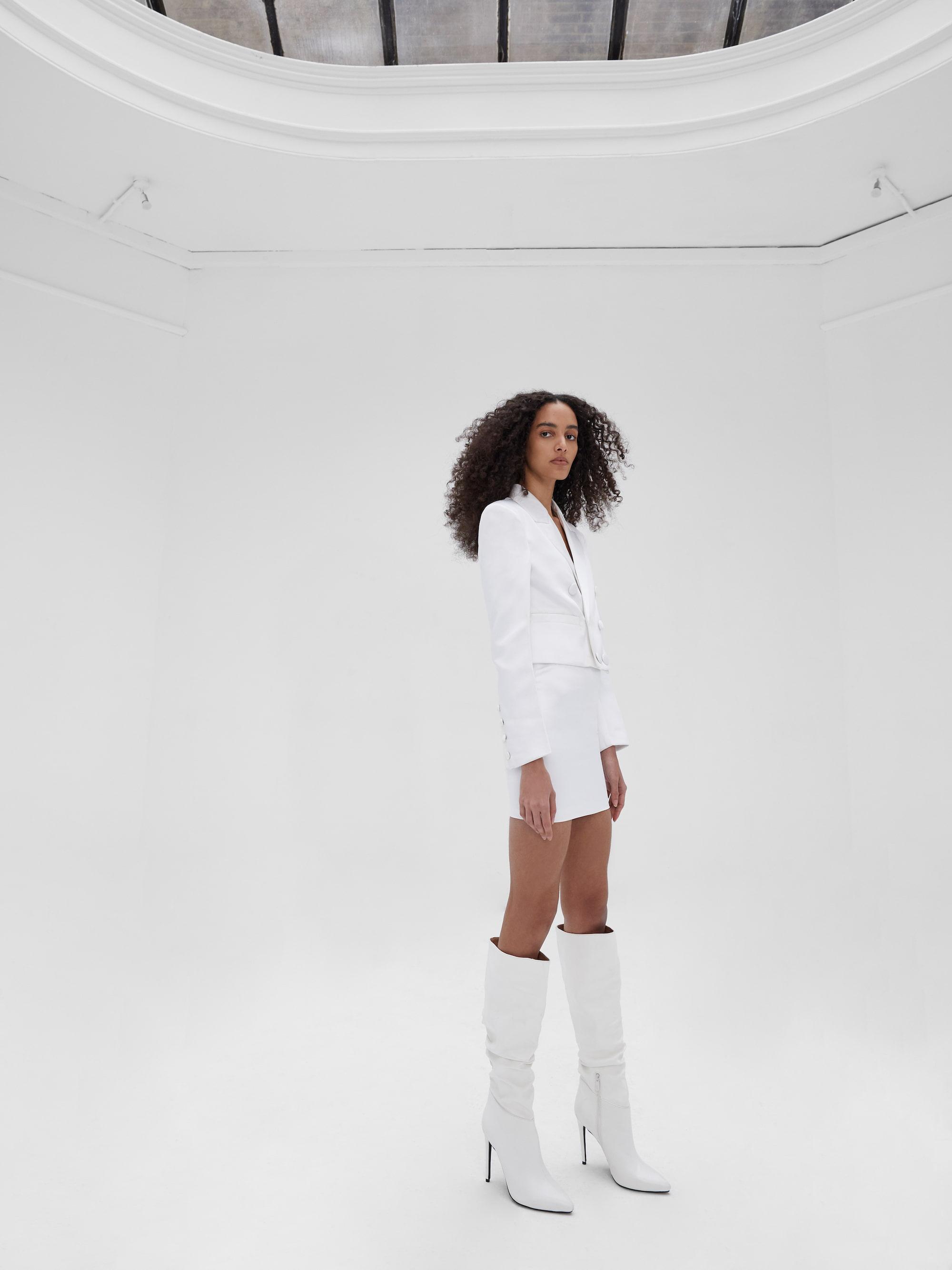 View 4 of model wearing Kin Cropped Blazer in black.
