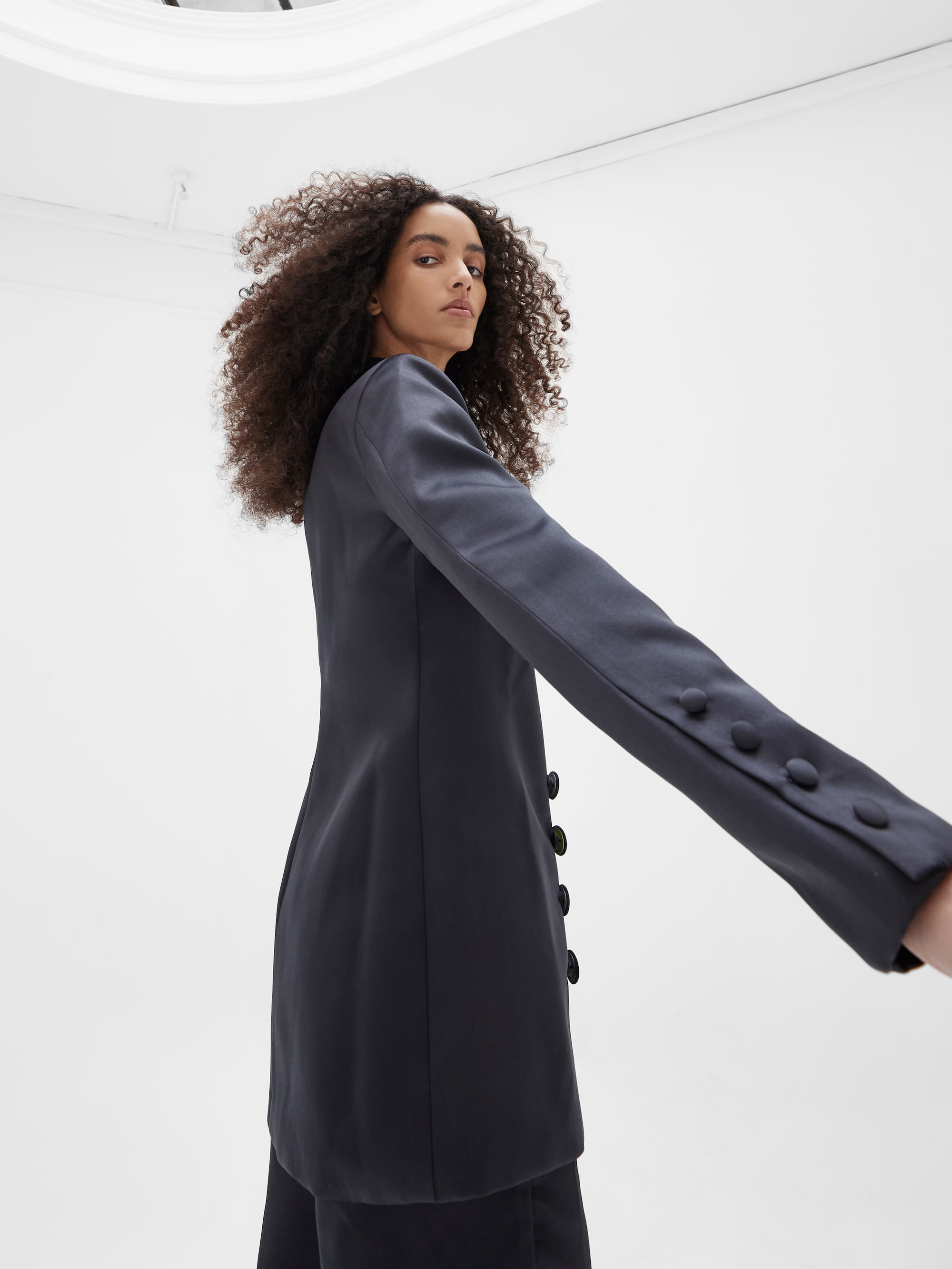 View 2 of model wearing Kamala Blazer in black.