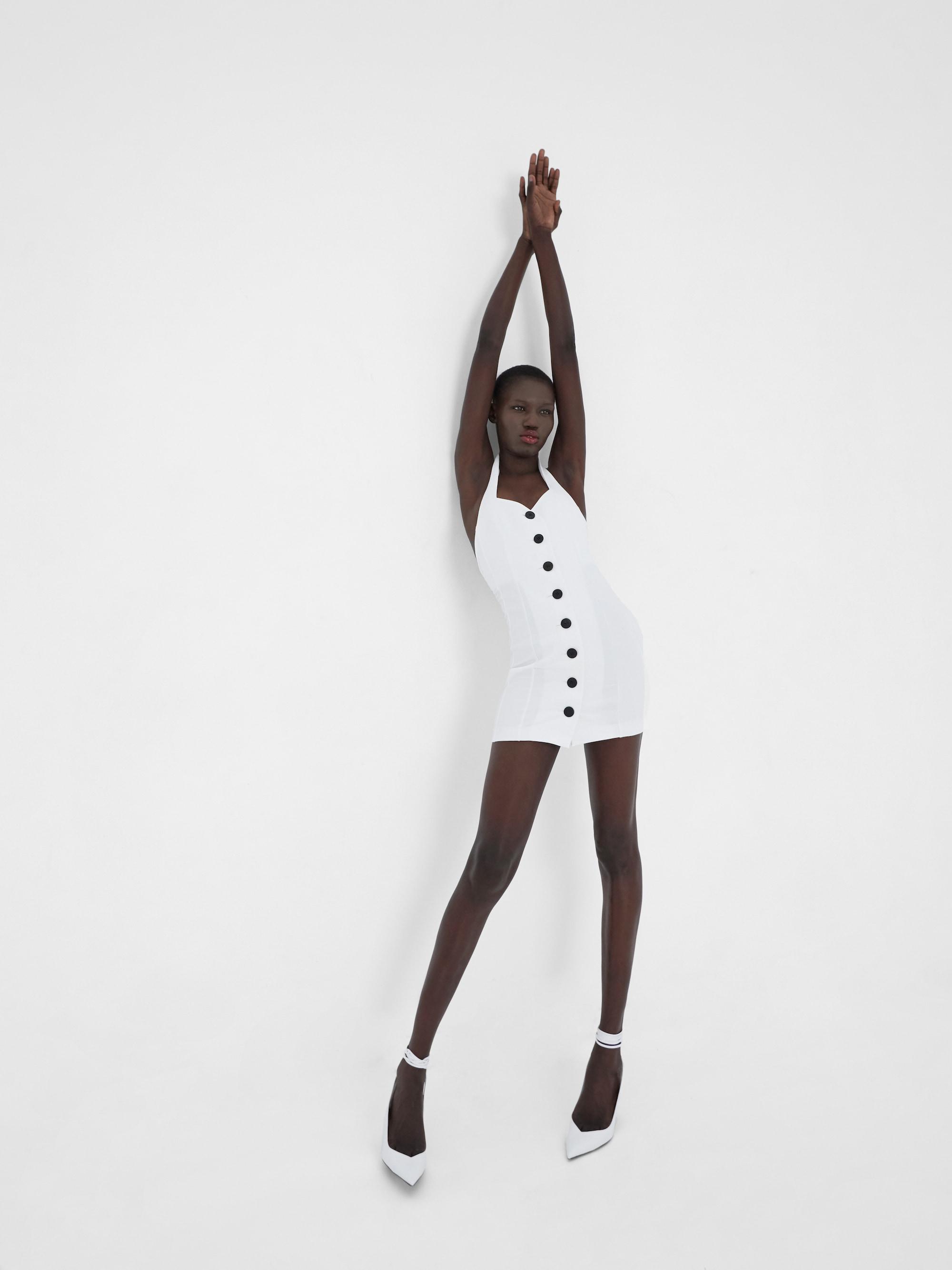 View 2 of model wearing Klaz Mini Dress in ivory.