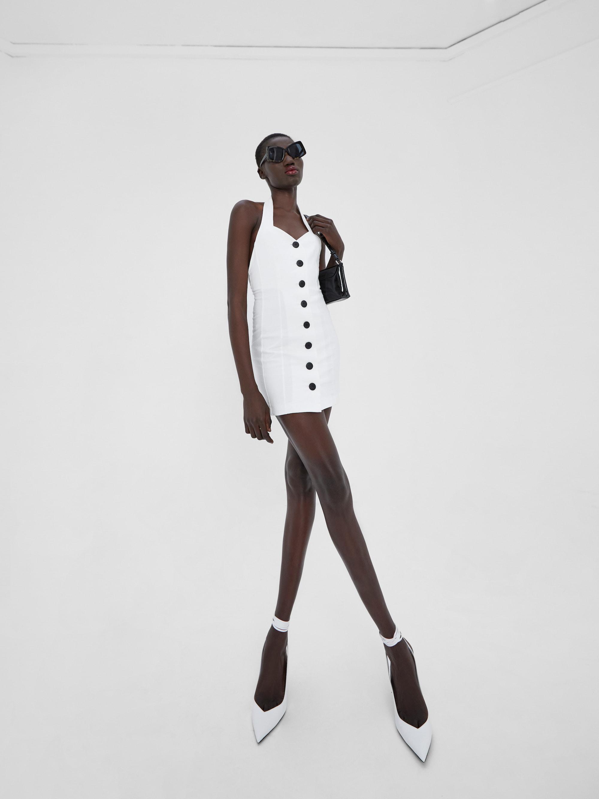 View 5 of model wearing Klaz Mini Dress in ivory.