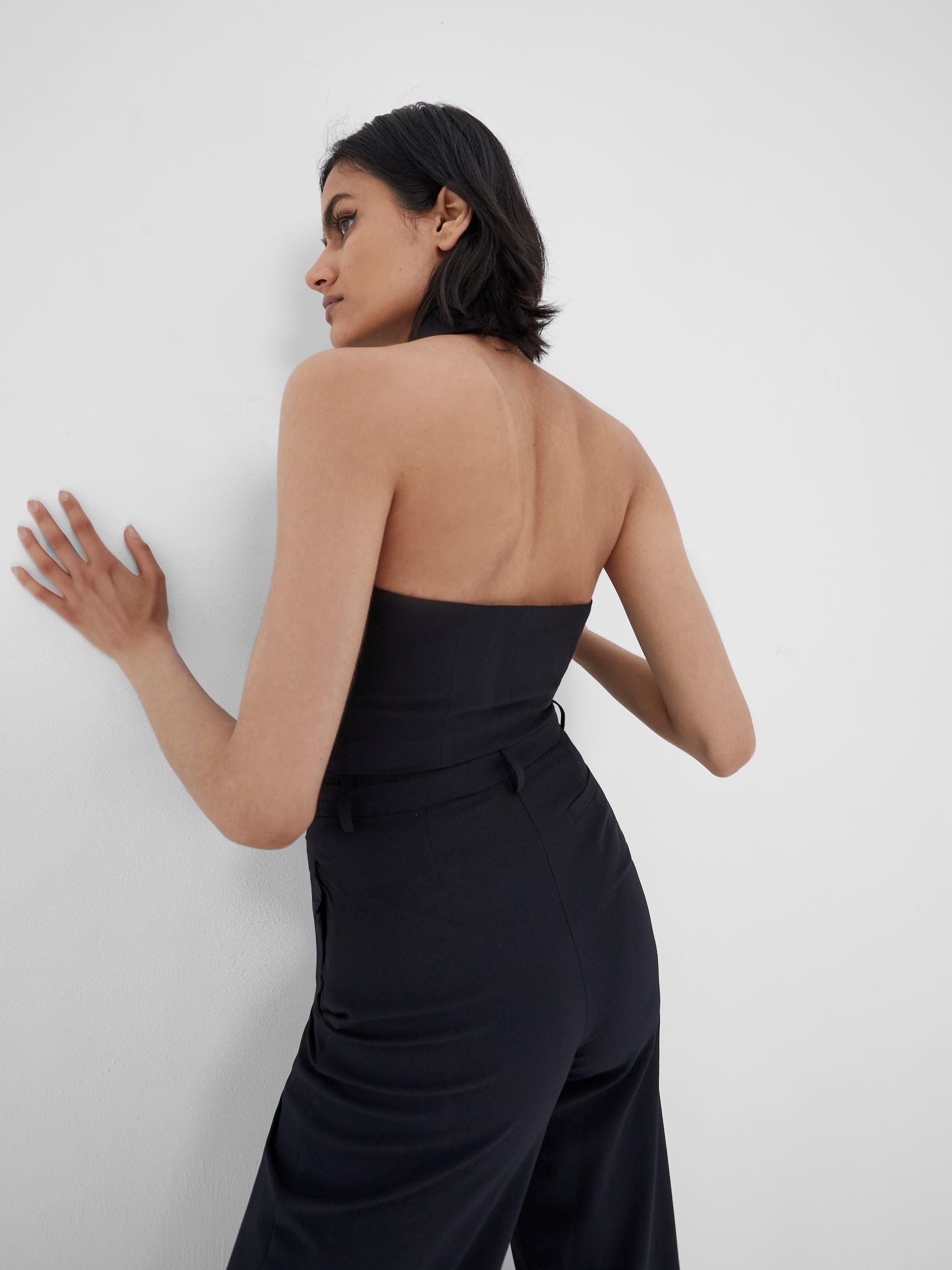 View 2 of model wearing Kamee Suit Vest top in black.