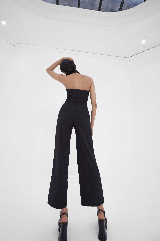View 4 of model wearing Kamee Suit Vest top in black.