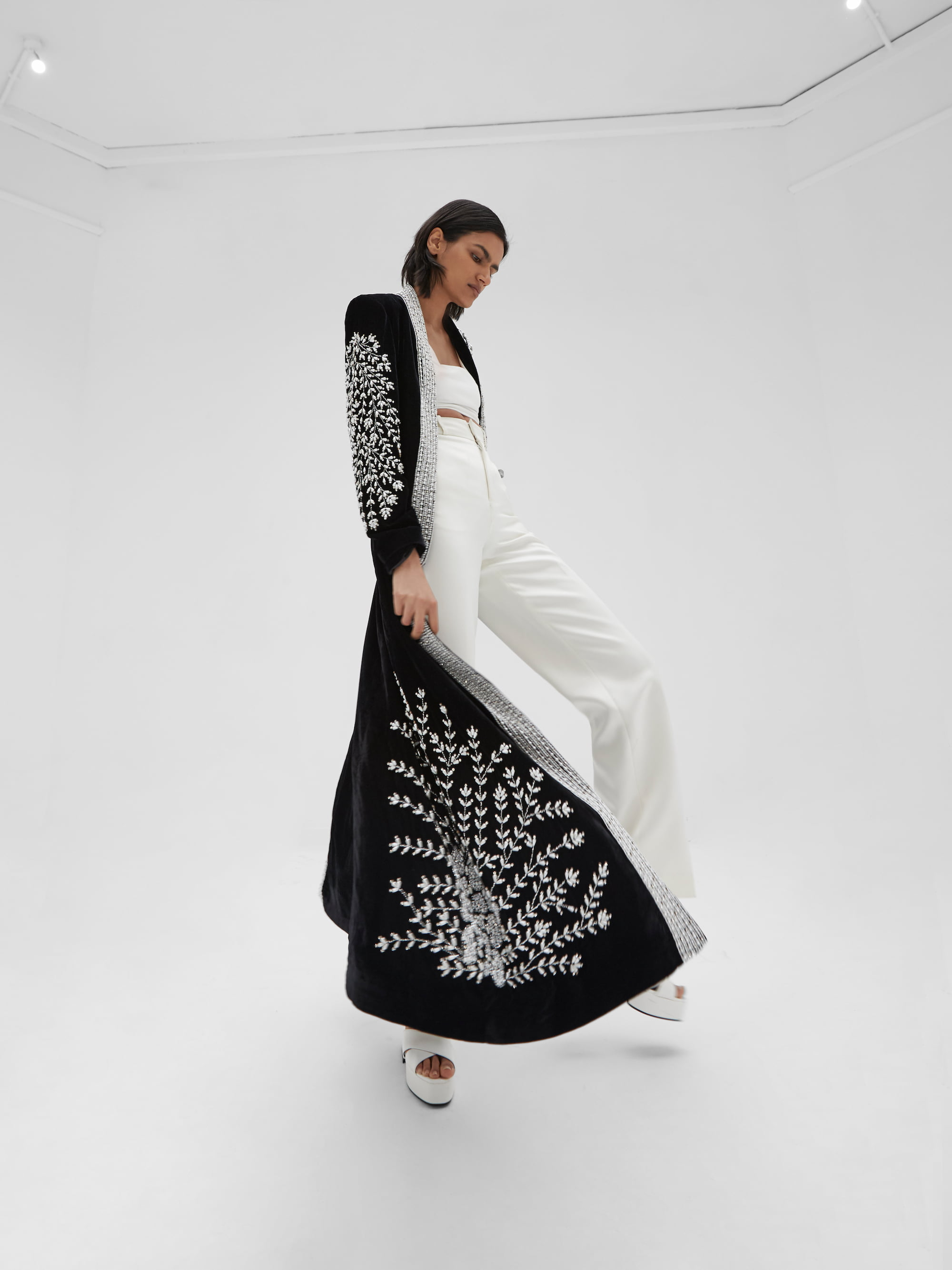 View 4 of model wearing Kamia Kimono in black.