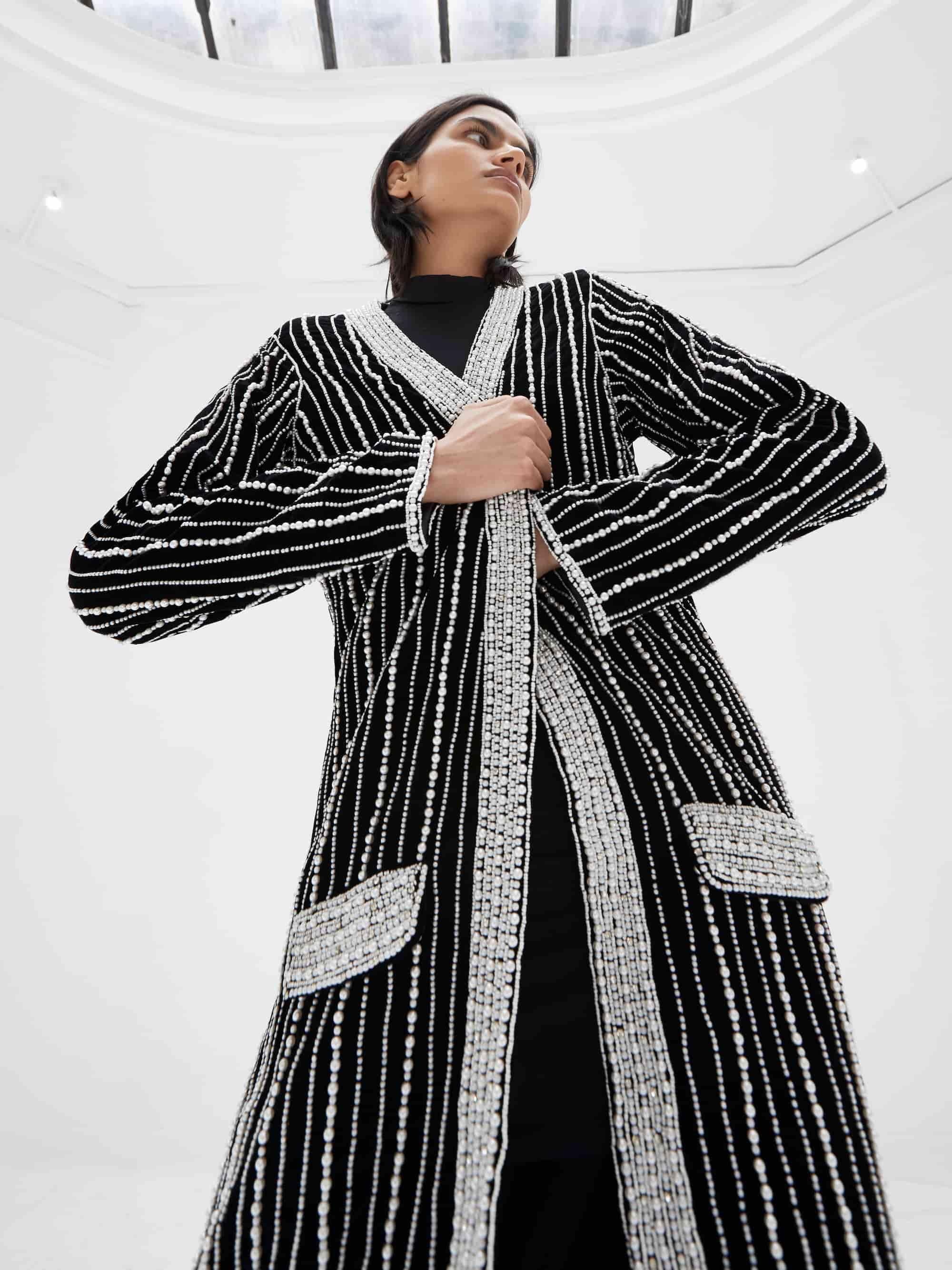 View 3 of model wearing Kasia Kimono in black.