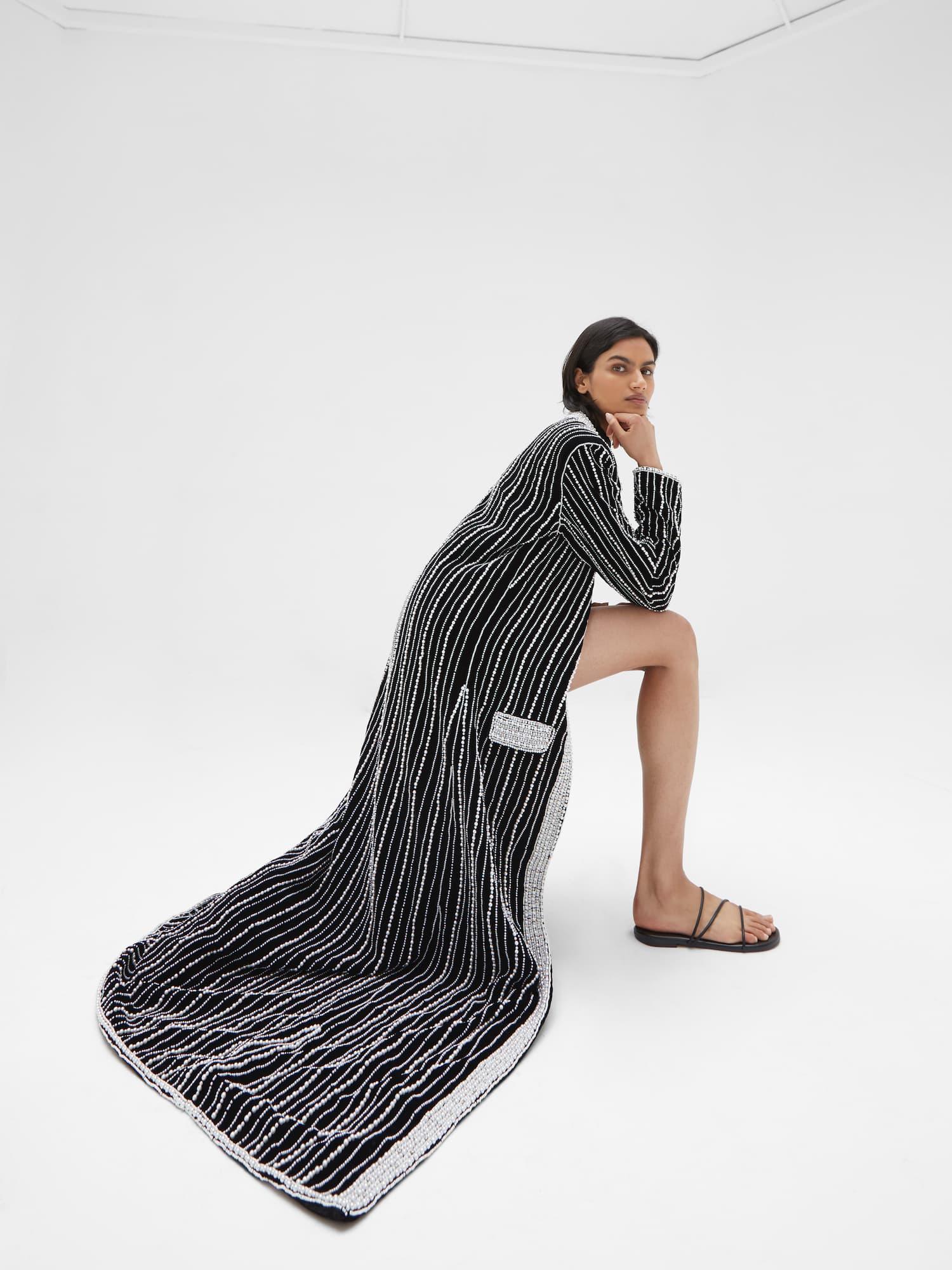 View 4 of model wearing Kasia Kimono in black.