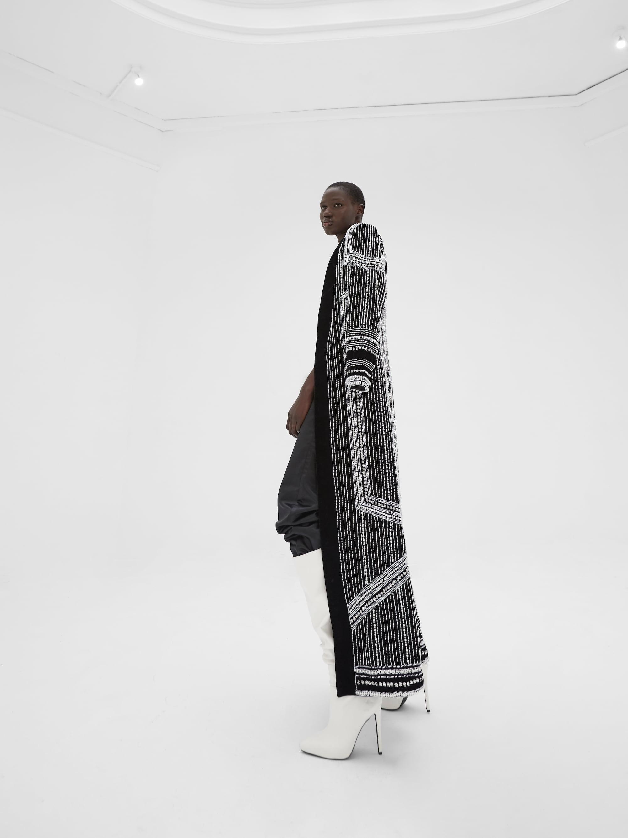 View 5 of model wearing Kainaaz Kimono in black.